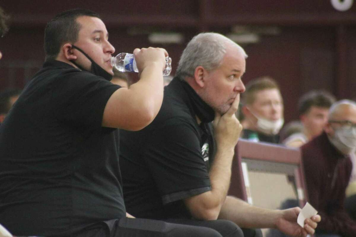 Pasadena High School boys basketball assistant coach Chance LaFour and head coach Jon Pillow have had a front-row seat to thie team's unprecedented climb to 22-6A's top spot, celebrated by all in Eagle Nation, including Principal Laura Gomez.