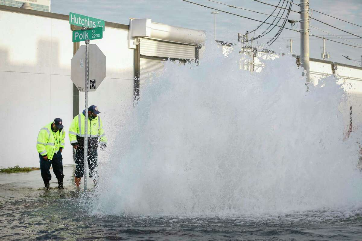 Public Works employees attempt to shut off the flow of water to a water main break in the EaDo neighborhood at Polk and Hutchins Tuesday, Feb. 2, 2021, in Houston.