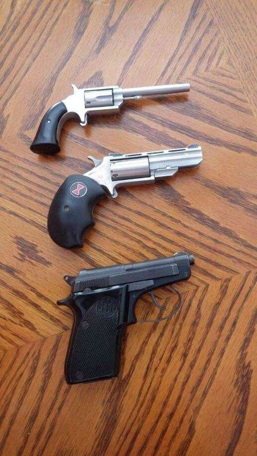 """The .22 rimfire round got its start as a self-defense round in 1857,a functionit still serves today in very concealable handguns. Pictured, from top, are theFreedom Arms """"Boot Gun,"""" North American Arms """"Black Widow,"""" andBeretta """"Bobcat."""" (Tom Lounsbury/Hearst Michigan)"""