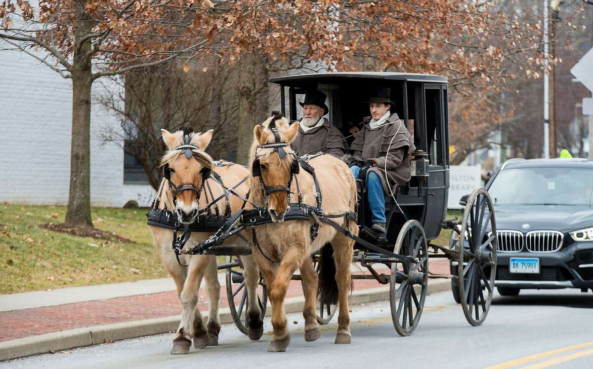 Visitors of the third Annual Winter Carnival ride a horse-drawn carriage in Wilton, Conn. on Sunday, Jan. 26, 2020. The event was presented by the Wilton Chamber of Commerce and sponsored by Fairfield County Bank. Visitors of the third Annual Winter Carnival ride a horse-drawn carriage in Wilton, Conn. on Sunday, Jan. 26, 2020. The event was presented by the Wilton Chamber of Commerce and sponsored by Fairfield County Bank.