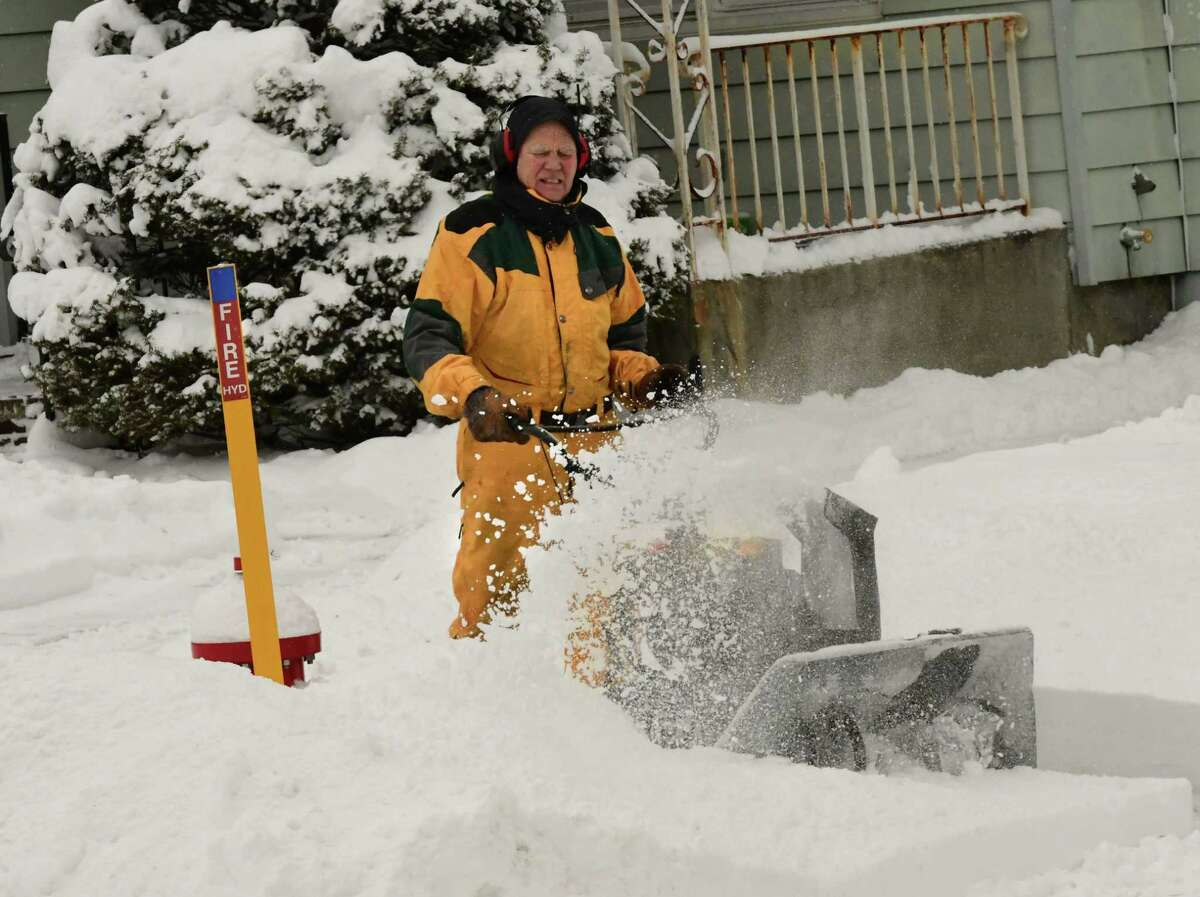 Sandy Gordon snow blows around a fire hydrant for an elderly neighbor after a nor'easter snow storm on Tuesday, Feb. 2, 2021 in Guilderland, N.Y. (Lori Van Buren/Times Union)