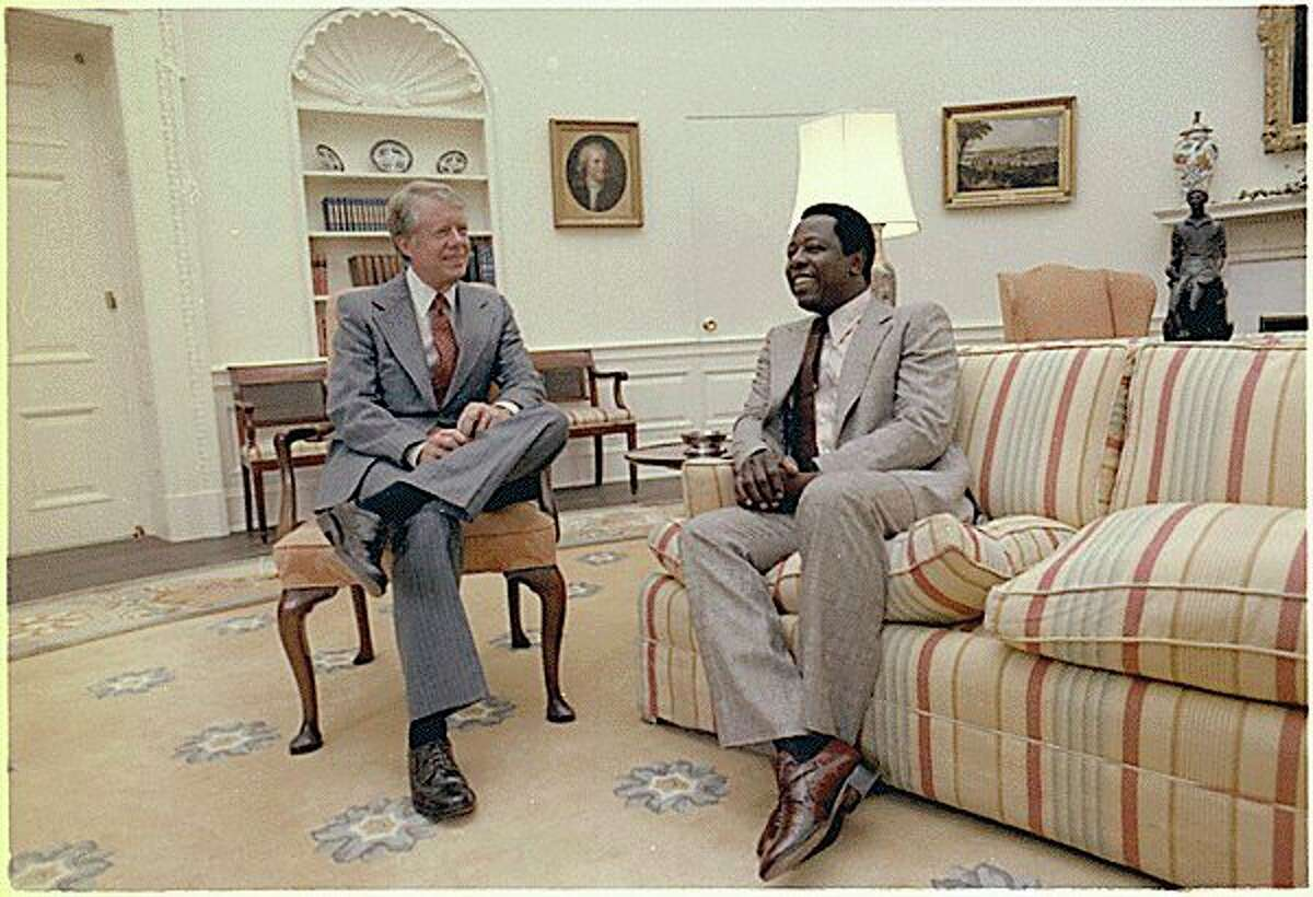 Former President Jimmy Carter talks with baseball legend Hank Aaron on Aug. 15, 1978. (Courtesy photo/National Archives)