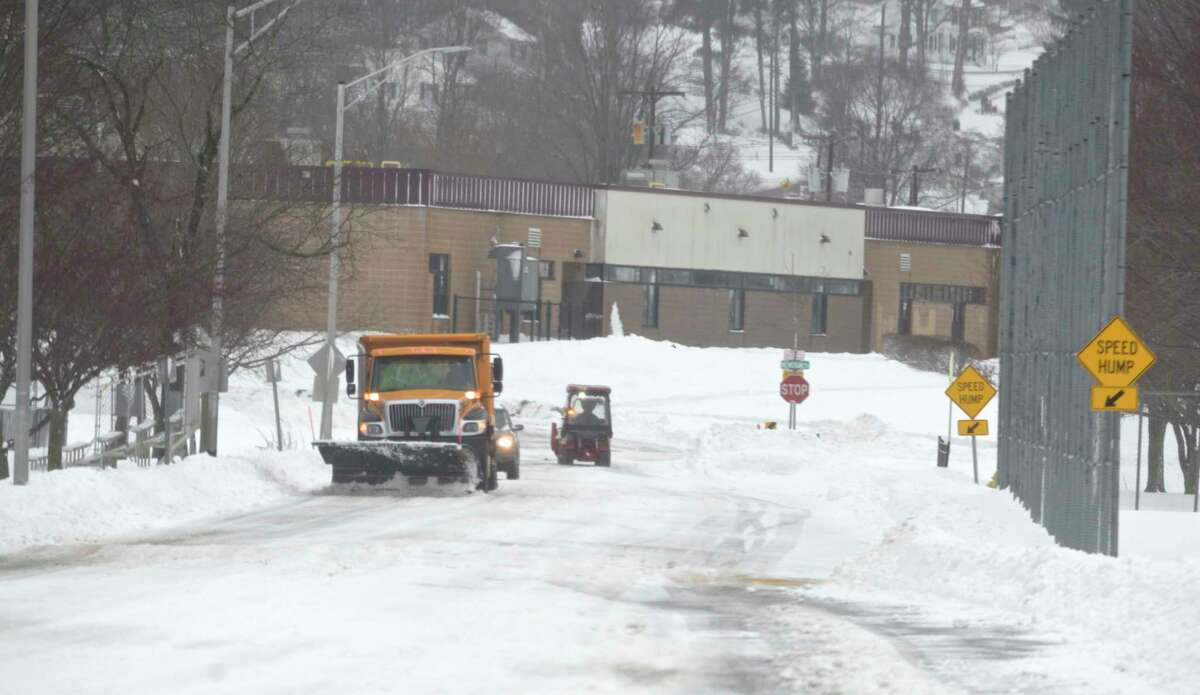 A city plow truck clears snow from a road in Rogers Park on Tuesday Morning. Tuesday, February 2, 2021, in Danbury, Conn.