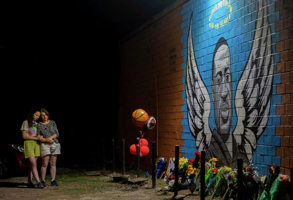 Visitors take in a mural honoring George Floyd in Houston this summer. Floyd's death captured this nation's attention. Now the moment demands legislative change.