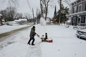 Jeff DeRosa, of Bethel, was out of the house early Tuesday morning cleaning the driveway and sidewalk of his downtown Bethel house. He also cleared the drive ways and sidewalks of a few of his neighbors as well. Tuesday, February 2, 2021, in Bethel, Conn.