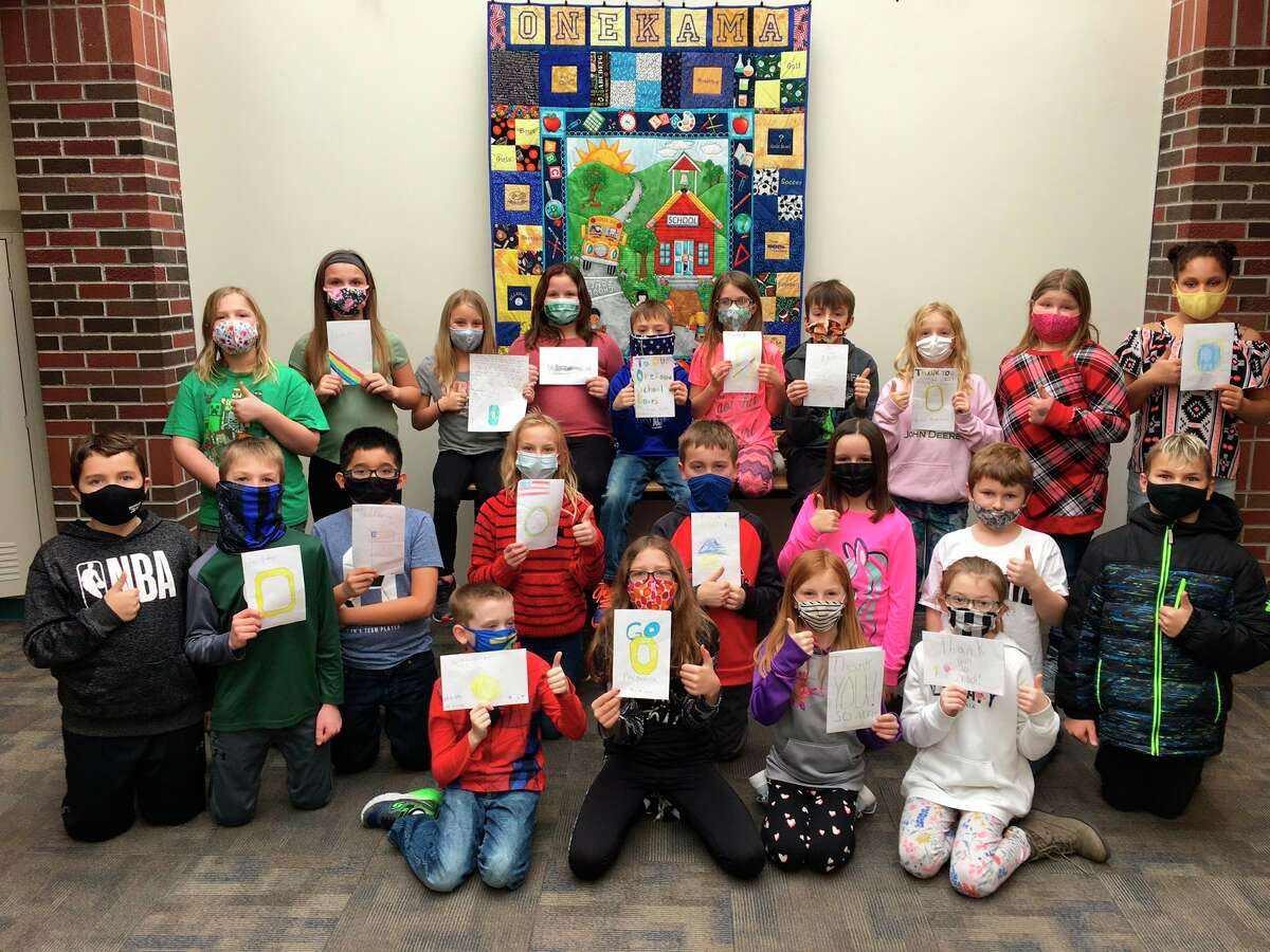 Fourth grade studentsat Onekama Consolidated Schools shows off the thank-you cards they made for the school board in honor of January being School Board Recognition Month. (Courtesy photo)