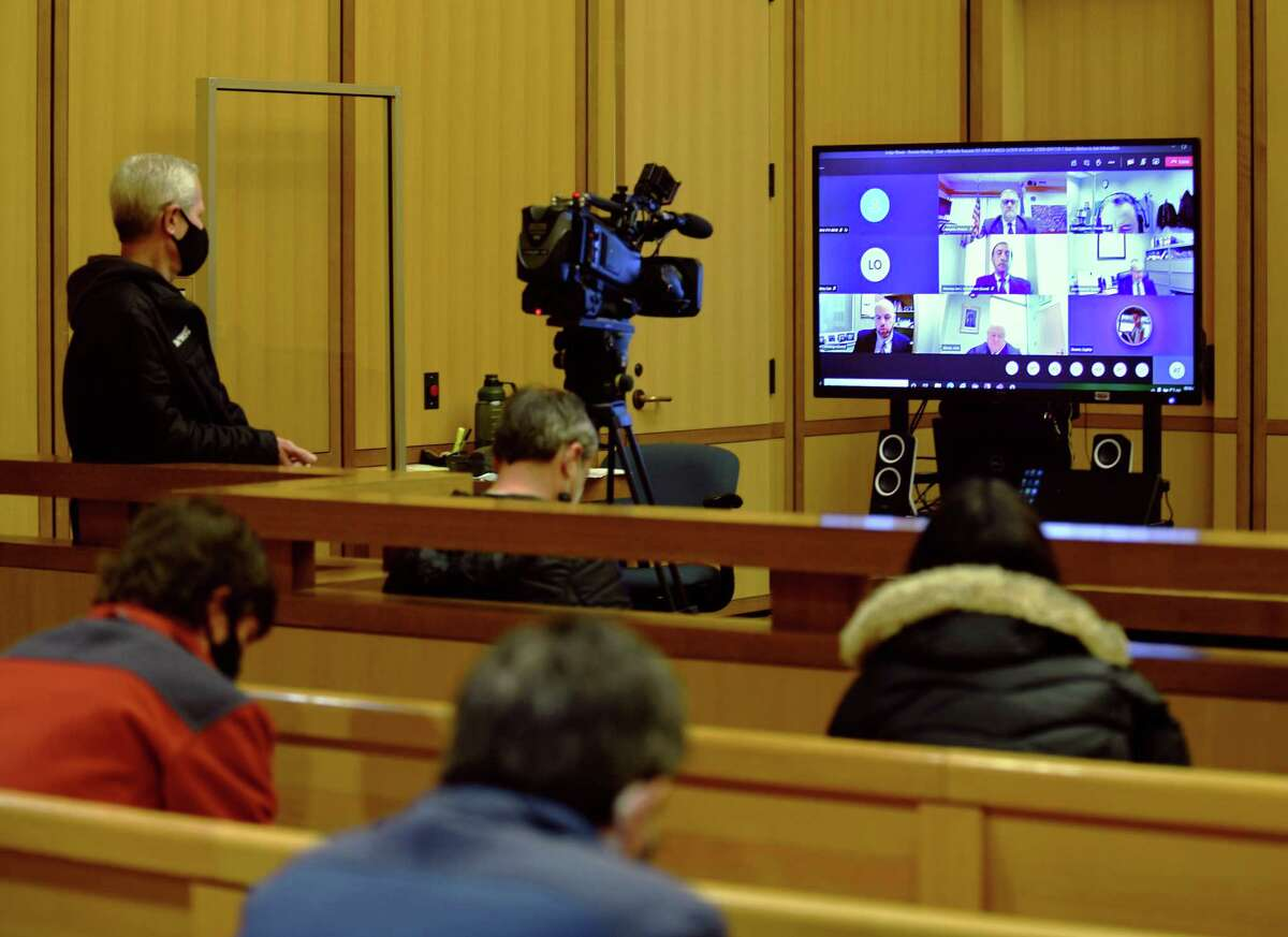 Members of the media gather to watch Michelle Troconis' virtual court appearance at the Connecticut Superior Court in Stamford, Conn. Tuesday, Feb. 2, 2021. Troconis, 46, remains free on more than $2 million bond for charges including conspiracy to commit murder, evidence tampering and hindering prosecution in connection with the disappearance of Jennifer Dulos.