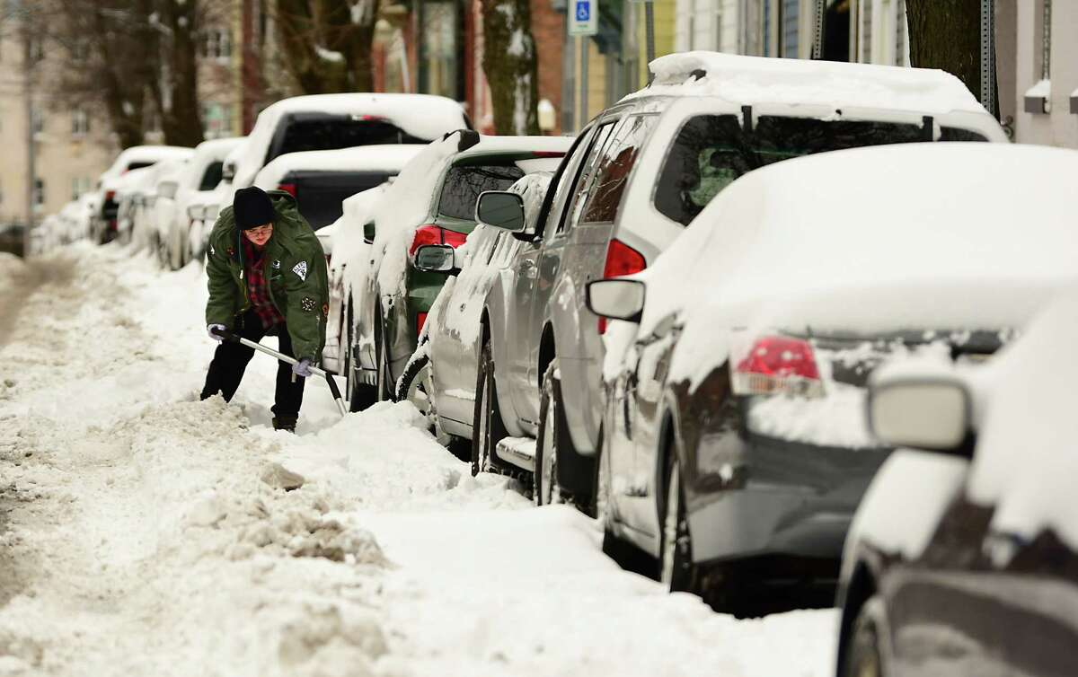 A person digs out their car downtown after a nor'easter snow storm on Tuesday, Feb. 2, 2021 in Albany, N.Y. (Lori Van Buren/Times Union)