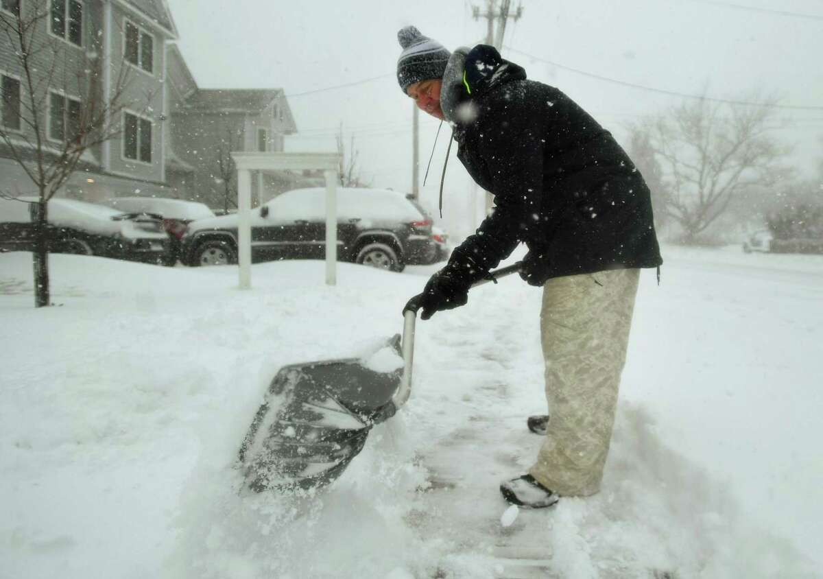 Topher Scheel gets a head start shovelling snow during the height of the blizzard in front of his home on Reef Road in Fairfield, Conn. on Monday, February 1, 2021.