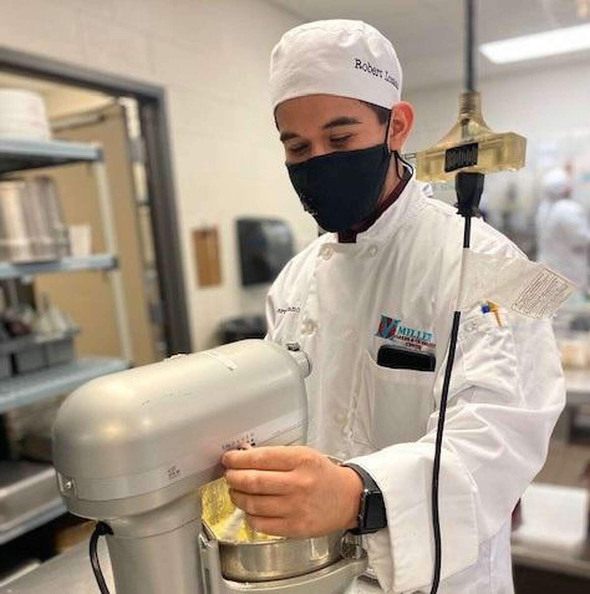 Katy Independent School District's Miller Career & Technology Center is hosting a virtual open house tonight. Here, Seven Lakes High School senior Robert Lozano works at MCTC's Old Town Bistro.