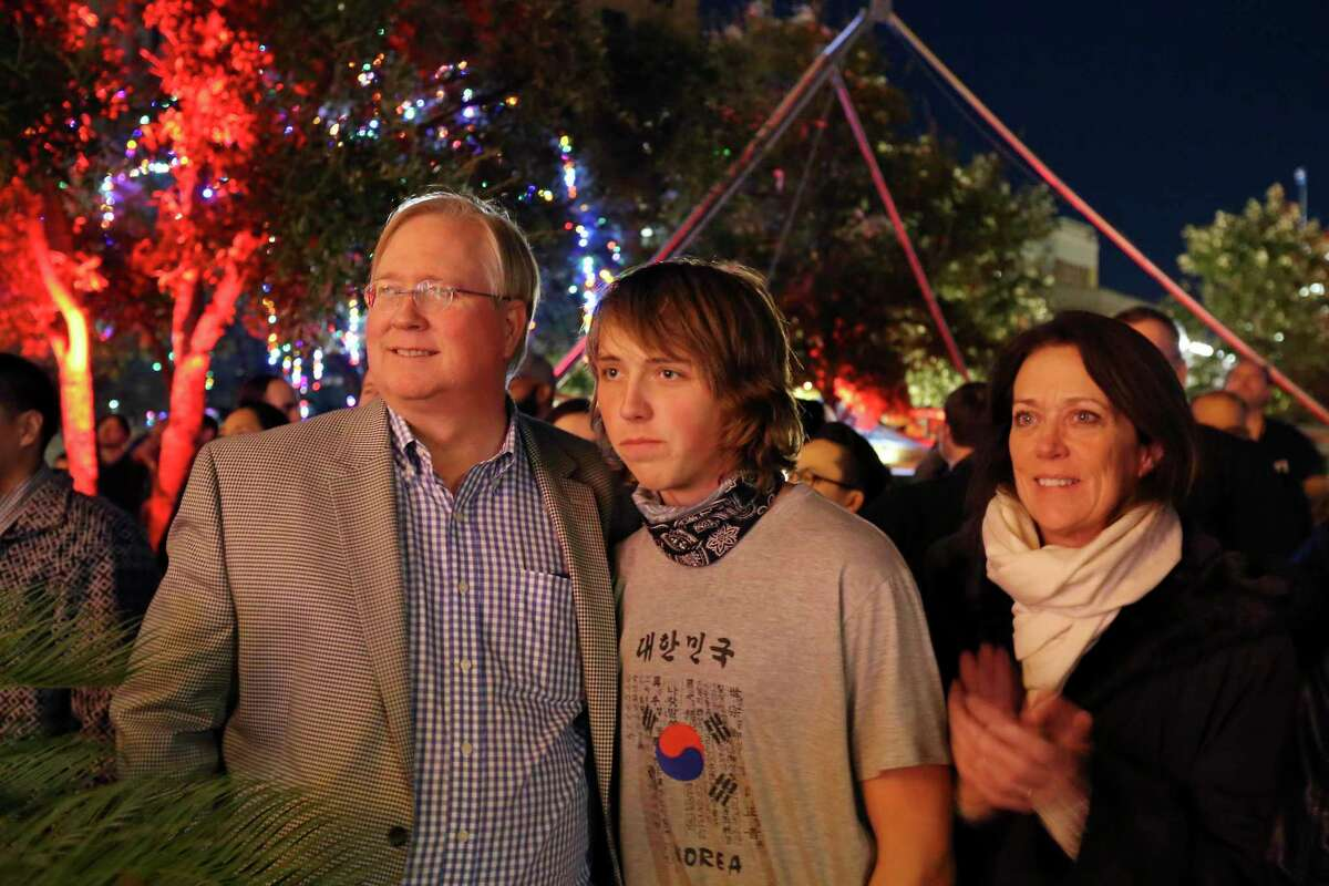 Graham Weston, left, son Glenn, and wife Elizabeth watch performers during Carnival Cuatro celebrating Geekdom's fourth birthday in 2015 in Main Plaza. Graham and Elizabeth Weston are now getting divorced.