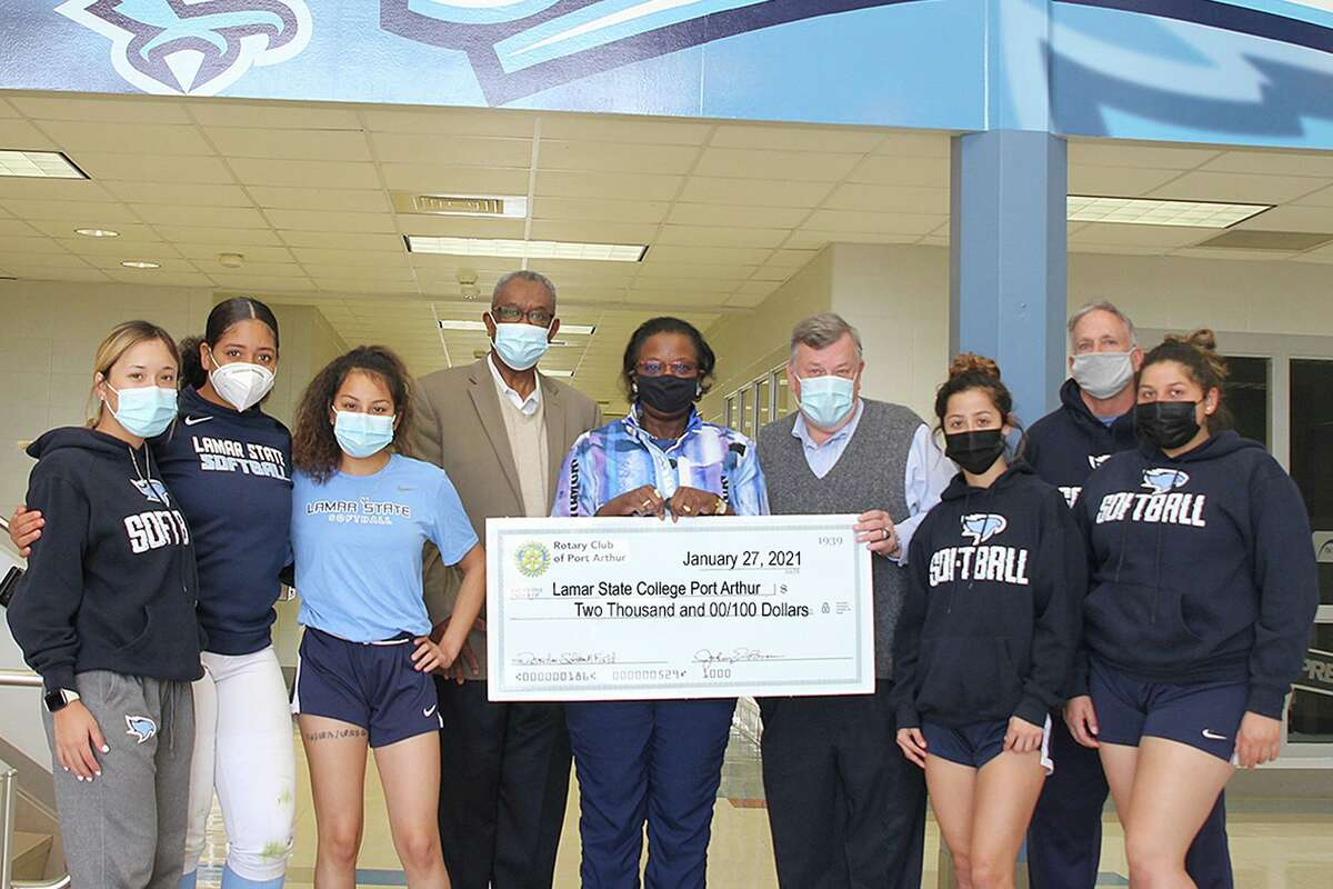 The Rotary Club of Port Arthur presented a $2,000 check to Lamar State College Port Arthur's Athletics Department this past week to help pay for repairs to the Seahawks' softball park, Martin Field, after damage caused by Hurricane Delta. Seahawks softball players, from left, Brianna Ramirez, Gabby Tims, Alexa Gracia, LeeAnn Hinojosa, Kaitlyn Samarripa and coach Vance Edwards flank the Rotary Club's president, Dr. Johnny Brown, Rotary treasurer Mrs. Delilah Francis, and LSCPA Director of Athletics Scott Street. Photo taken 1/27/21