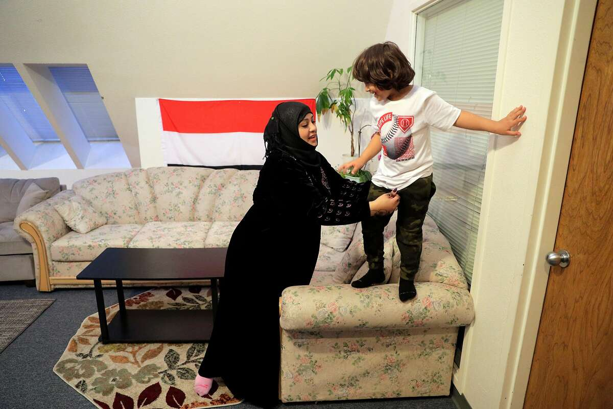 Horea Alroaini, with her son Tariq Nassir, 5, in the offices of Yemen American Network in Oakland, Calif., on Monday, February 1, 2021. Alroaini is the CEO of Yemen American Network. She immigrated to New York in 2012 and to California in 2013. She got a green card through marriage, but her brother Tariq had to leave when his visa expired. They spent four years trying to get him back, while her mother grew depressed. The travel ban in 2017 made things more complicated for them, but they were able to bring him that same year. Now he is in the military and a U.S. citizen.