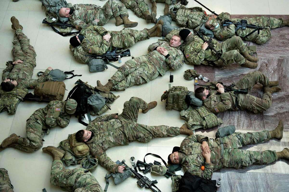 National Guard troops rest in the Capitol Visitors Center in Washington, D.C. on Jan. 13.