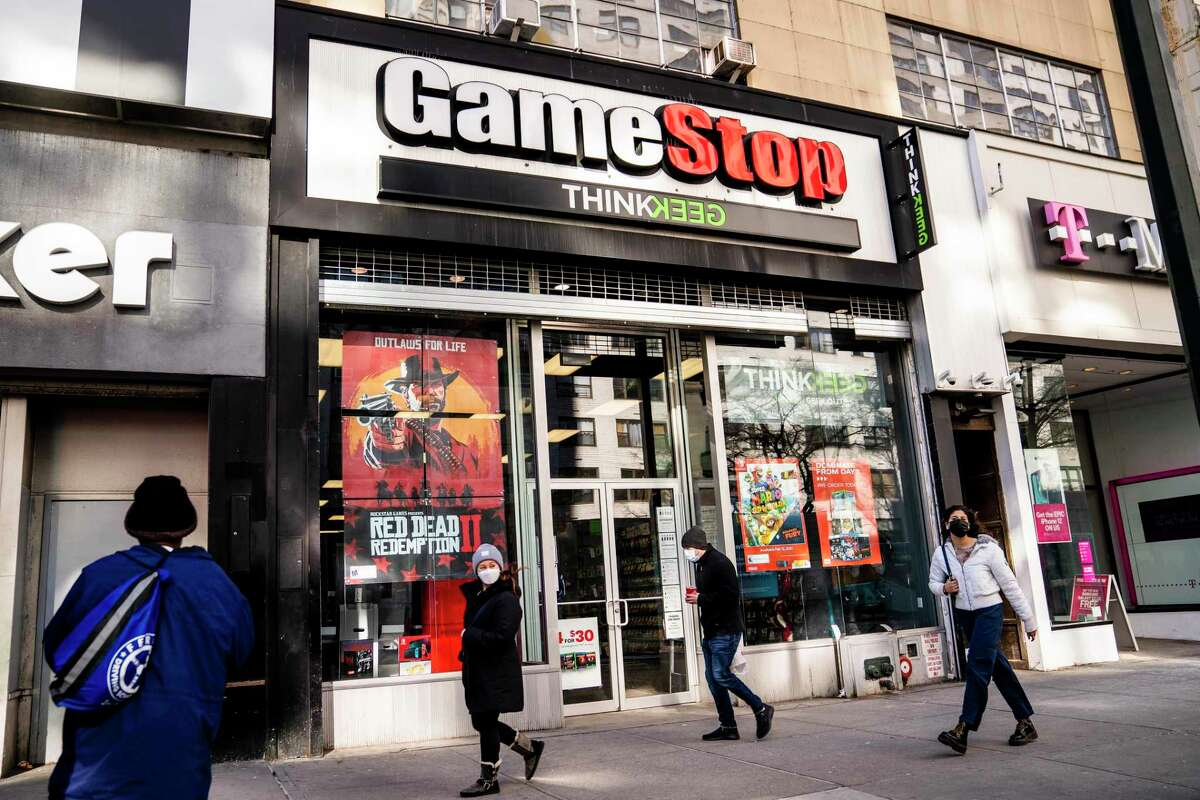 Pedestrians pass a GameStop store in Manhattan. GameStop shares are on track for their biggest one-day loss ever, extending a skid that's cleaved off some of its recent blockbuster gains following a social-media led campaign to get the videogame retailer's stock to skyrocket. Shares were down 46% to about $120 in morning trading Tuesday, Feb. 2, following a 31% decline a day earlier.