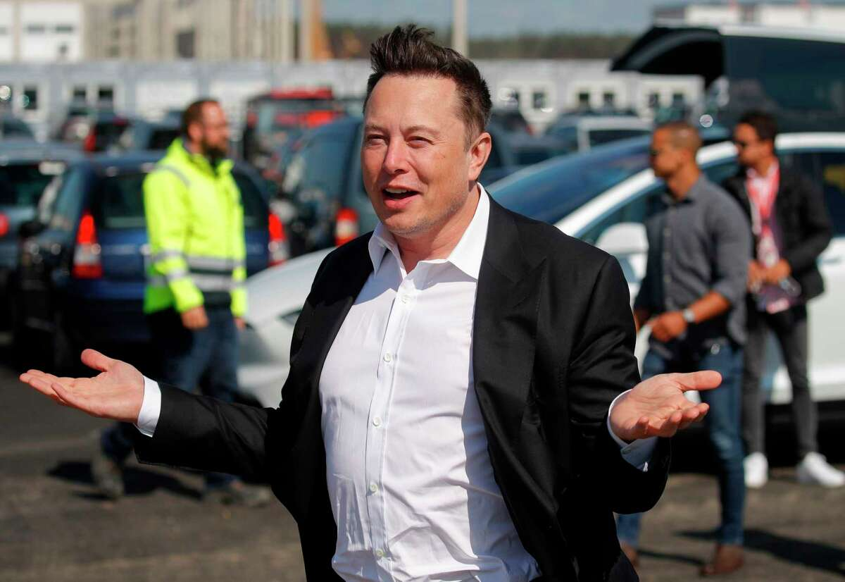 Tesla CEO Elon Musk gestures as he arrives to visit the construction site of the future US electric car giant Tesla, on September 03, 2020 in Grünheide near Berlin. - With his social media prognostications about Bitcoin or GameStop, Elon Musk has been venturing further away from his own businesses and becoming more like a Wall Street heavyweight who can move markets with just a few words.