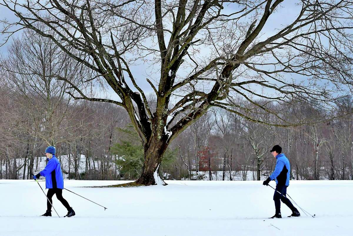 Melissa and Brian Lonegran of Branford enjoy the aftermath of Monday's snowstorm cross country skiing across Pine Orchard Country Club in Branford Tuesday.
