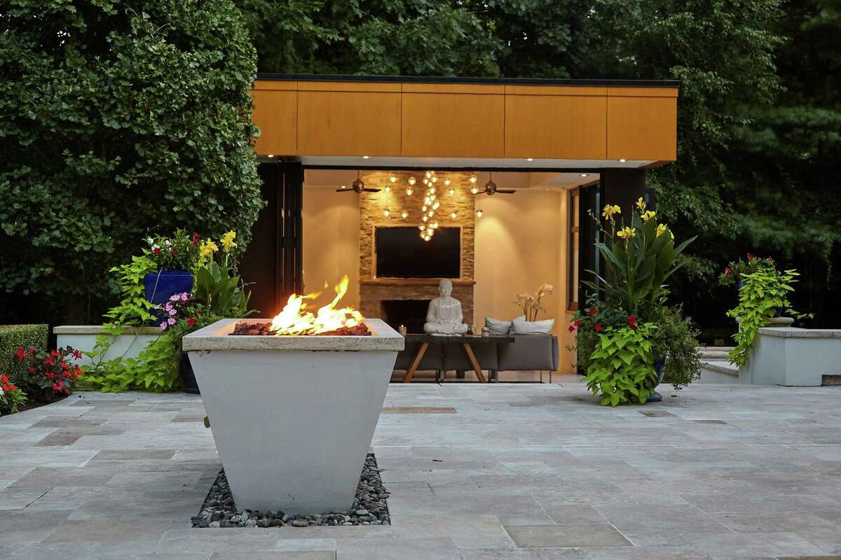 Glass serenity house with fireplace at 17 Woodway Lane, Westport.