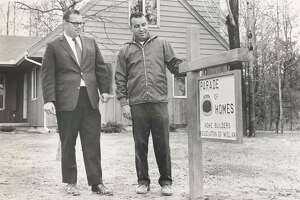 Matthew Crawford, left, chairman of the 1969 Parade of Homes, Home Builders Association of Midland, stands with Robert Campbell, association president. May 1969