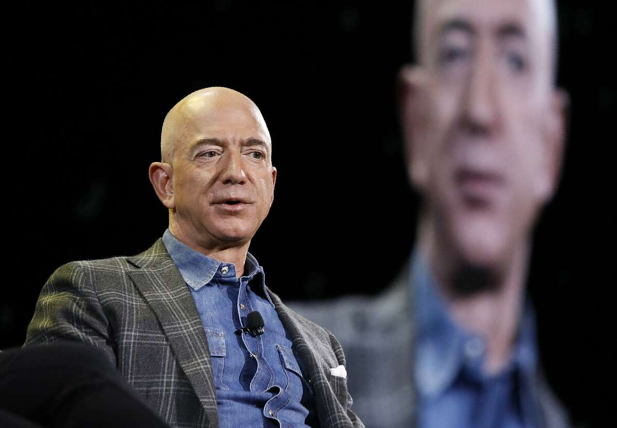 FILE - In this June 6, 2019, file photo Amazon CEO Jeff Bezos speaks at the the Amazon re:MARS convention in Las Vegas.