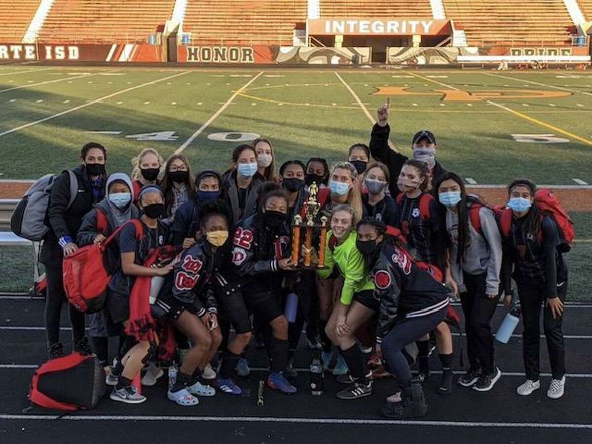 The Dawson girls' soccer team, shown here after winning the La Porte tournament, is hoping to continue its victorious ways in district play.