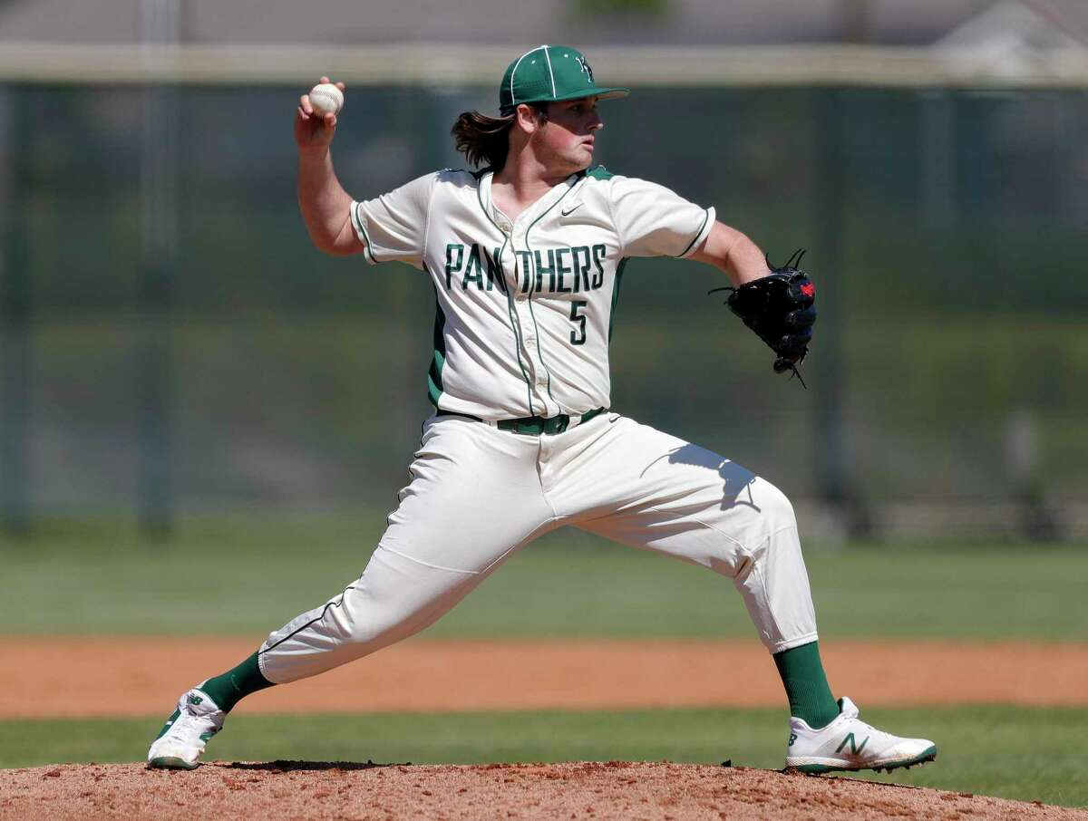 Kingwood Park pitcher Tyler Ward (5) tires to pick off a runner at first during a non-district high school baseball game at Kingwood Park High School, Thursday, Feb. 27, 2020, in Kingwood. The Woodlands defeated Kingwood Park 10-0.