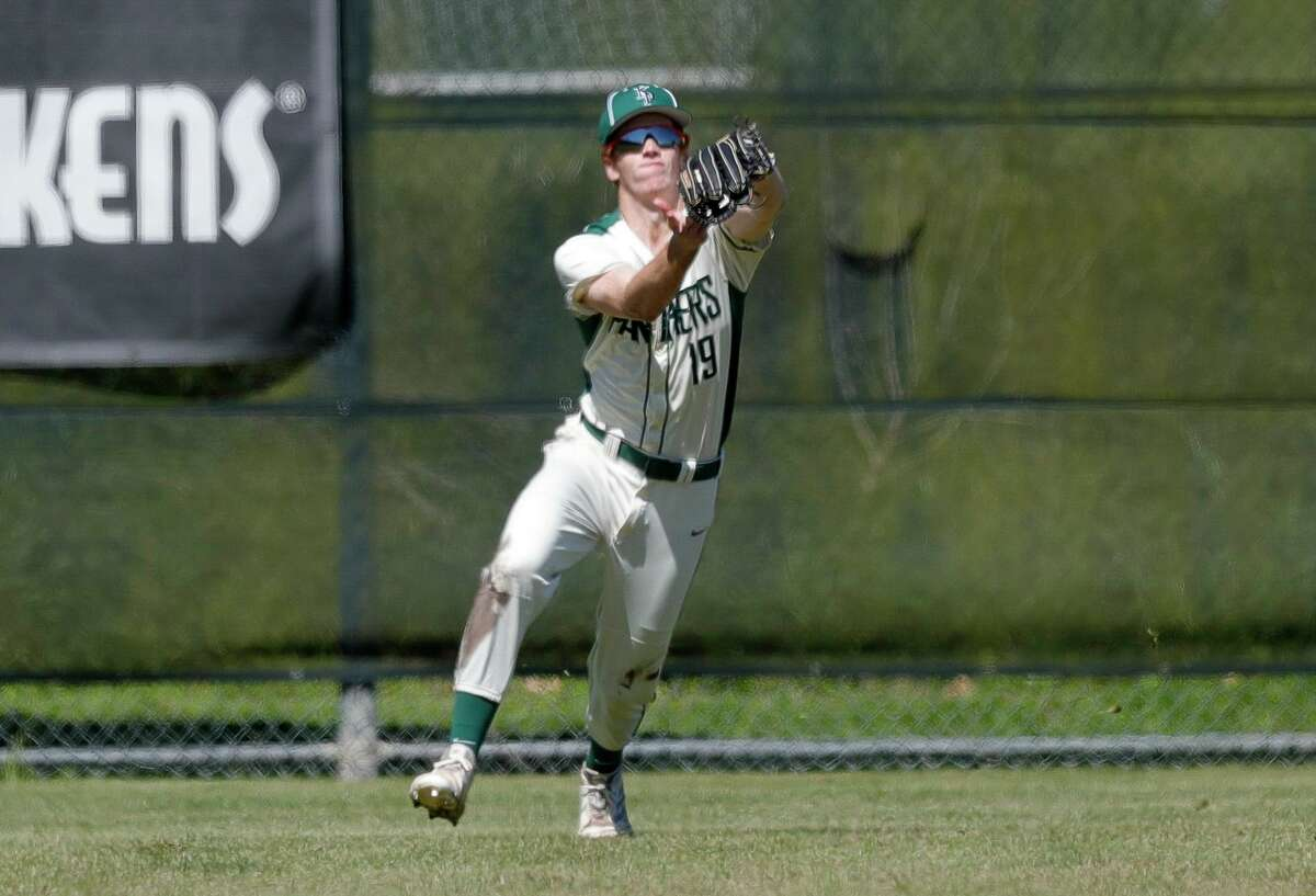 Kingwood Park left fielder Caleb Sowell (19) fields a fly ball during a non-district high school baseball game at Kingwood Park High School, Thursday, Feb. 27, 2020, in Kingwood. The Woodlands defeated Kingwood Park 10-0.