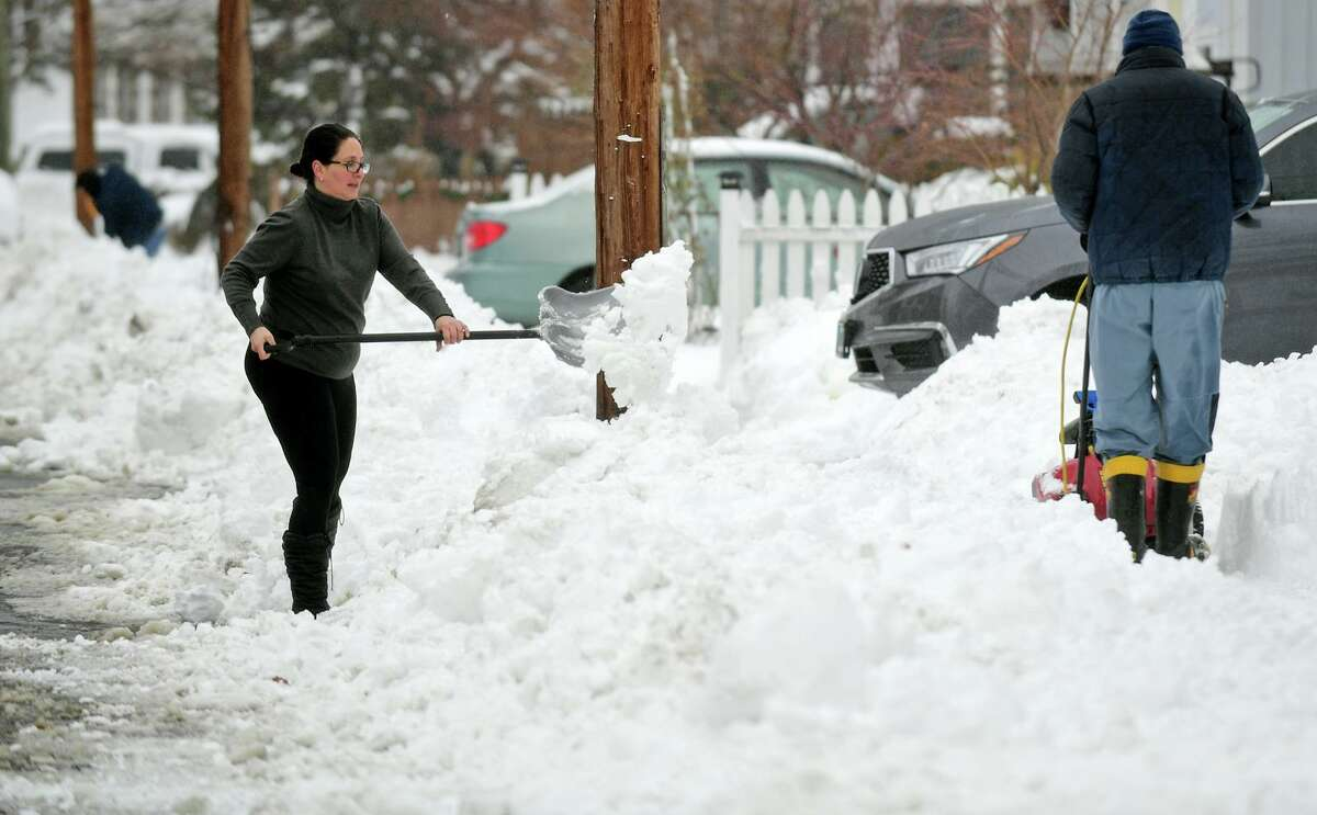 Norwalk resident Patty Fabrizio shovels her driveway on Ohio Street after the snowstorm Tuesday, February 2, 2021, in Norwalk, Conn