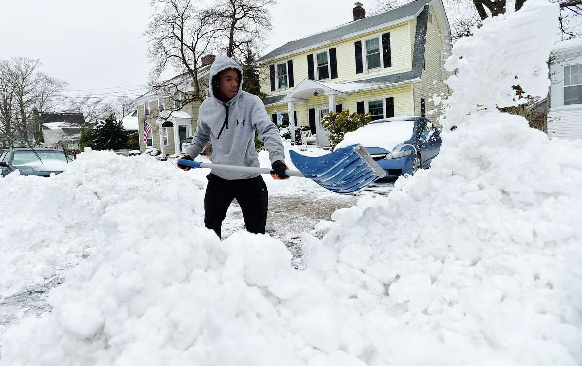 Norwalk resident Javon Brown shovels his driveway on Ohio Street following the snowstorm Tuesday, February 2, 2021, in Norwalk, Conn
