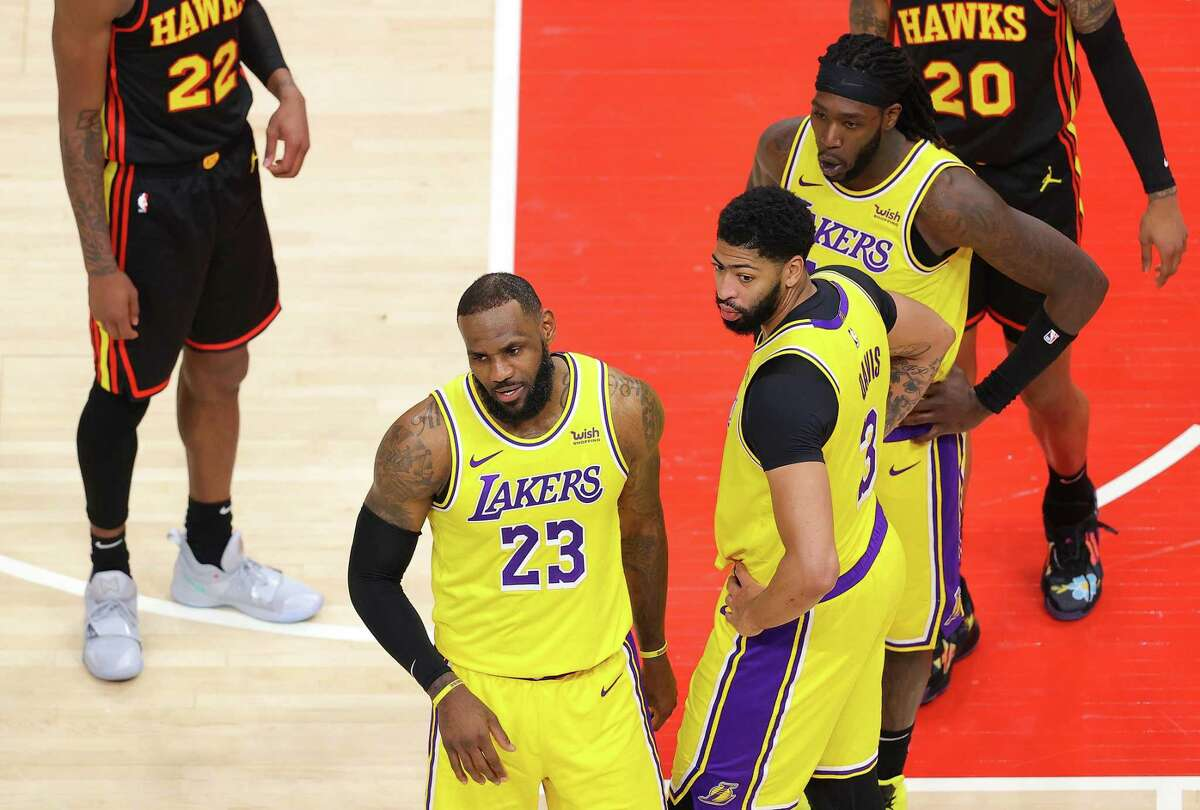 LeBron James of the Los Angeles Lakers reacts to a fan courtside during the second half against the Atlanta Hawks at State Farm Arena on Feb. 1, 2021.