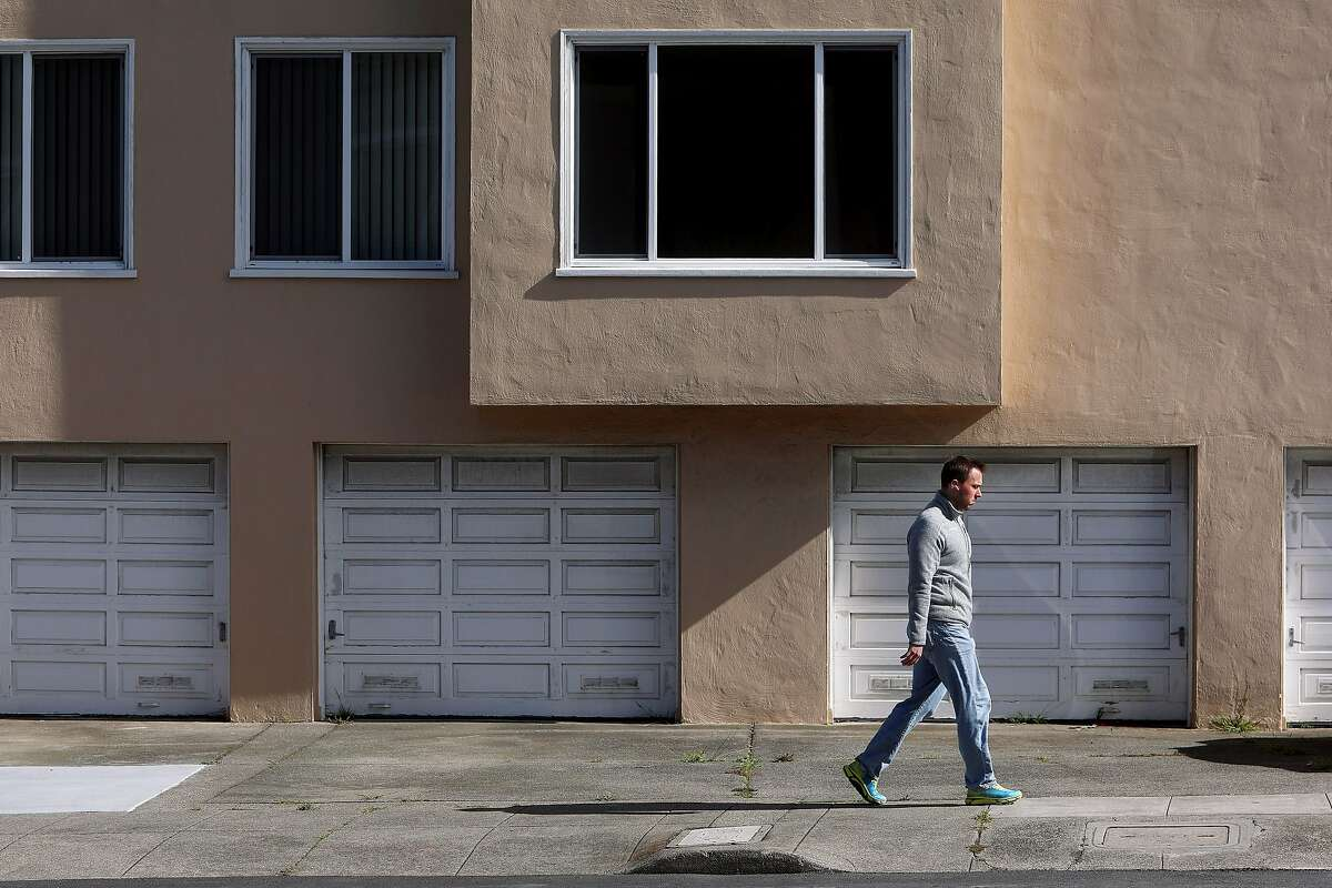 Justin Welter, a resident of the Anza Vista neighborhood, walks blocks from where an 84-year-old man was attacked Saturday and later died of his injuries.
