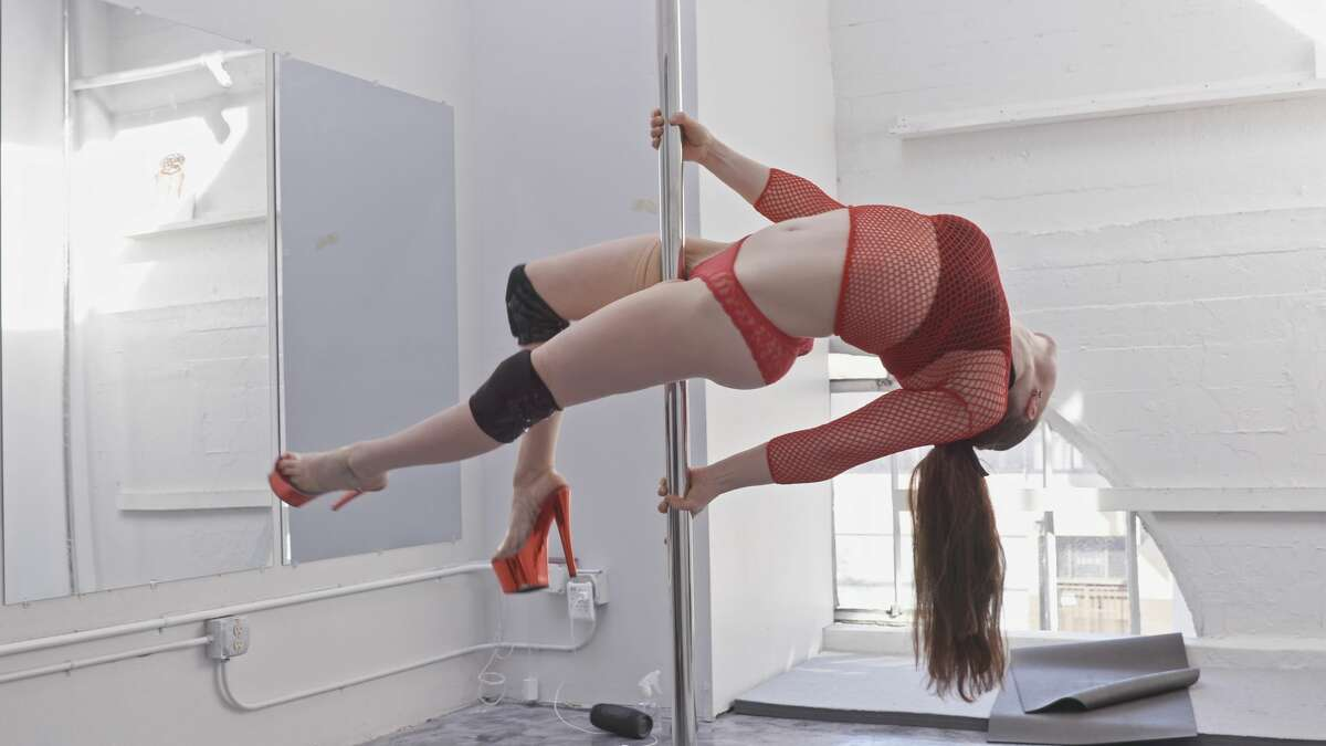 Allison effortlessly glides around the pole at San Francisco Pole and Dance in