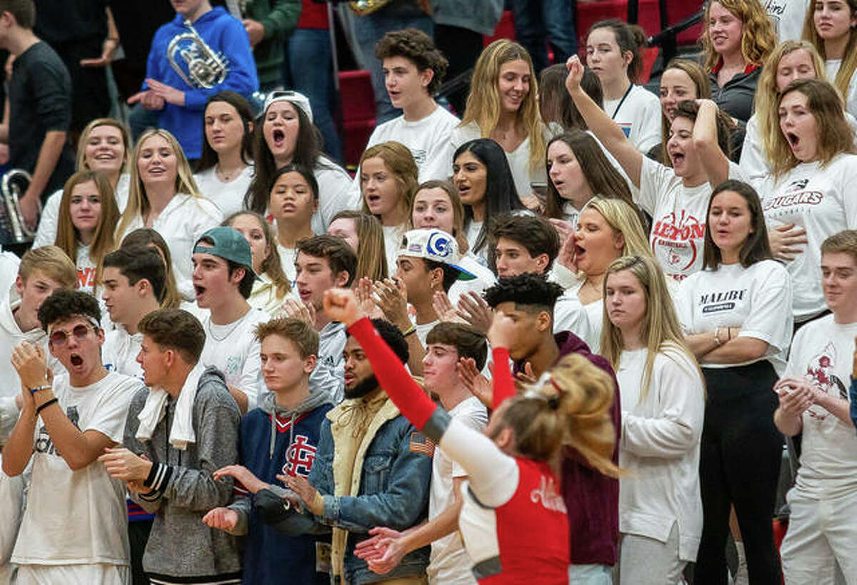 Alton students fill the Redbird Nest section of bleachers at a AHS boys basketball game last year at Alton High in Godfrey. If Region 4 moves to Phase 4 mitigation by the weekend, Alton will host Collinsville in three games Saturday, but with only 50 people spectators in the gym. Currently, the region is in Tier 2.