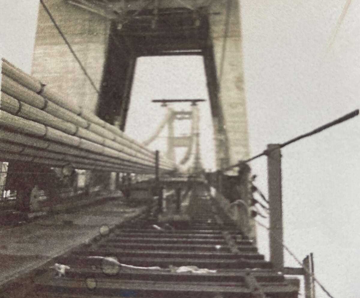 George Dondero snuck past a guard in 1935 and walked up the catwalk of the Golden Gate Bridge, taking photos of the partially finished landmark along the way.