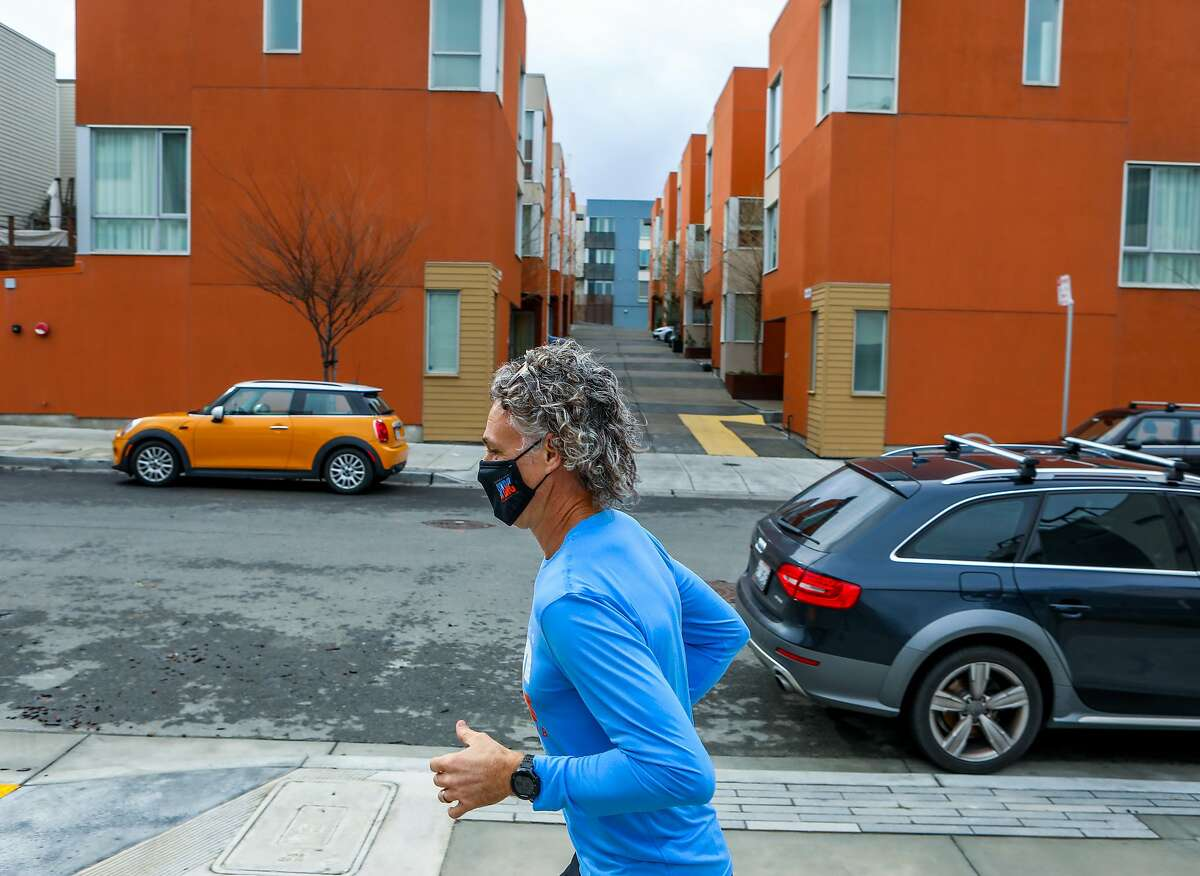 Troy Wilson, a realtor, runs at San Francisco's biggest housing development, the Shipyard, on Wednesday, January 27, 2021, in San Francisco, Calif. He moved into a condo there last year.