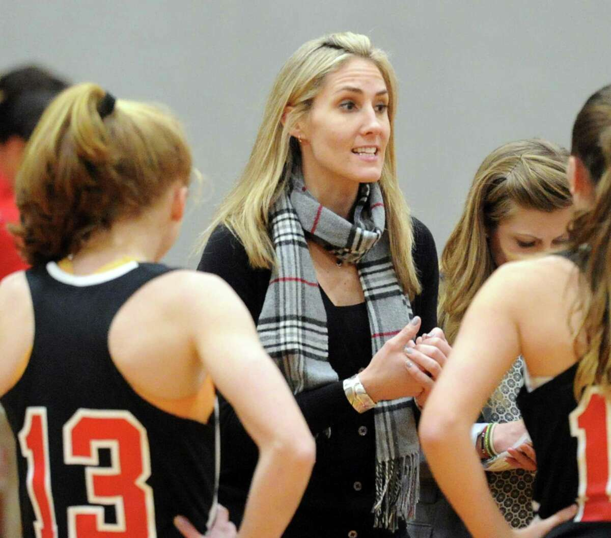Kim Palmer, who coached the New Canaan girls basketball tam for eight years before stepping down in 2017, has taken over as head coach for the 2021 season.
