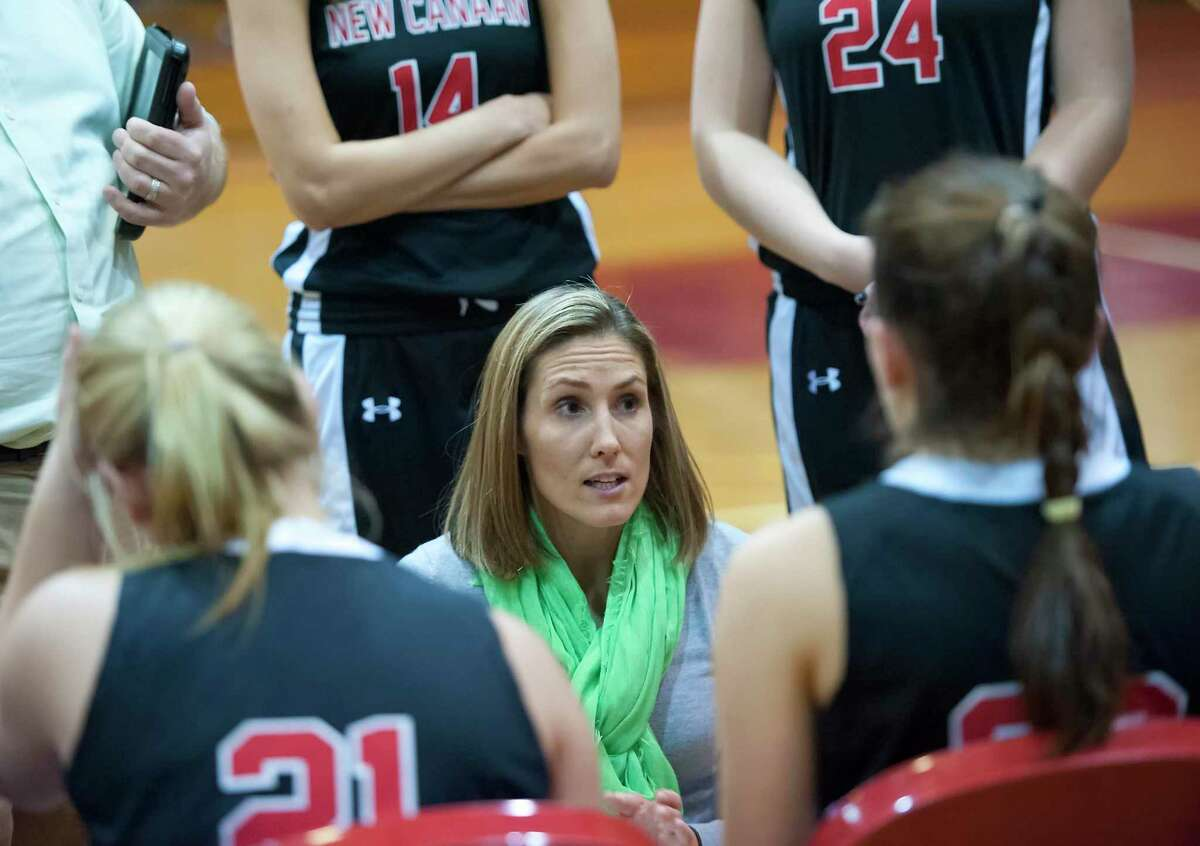 New Canaan girls basketball head coach Kim Palmer speaks to her team during a 2012 game against Greenwich