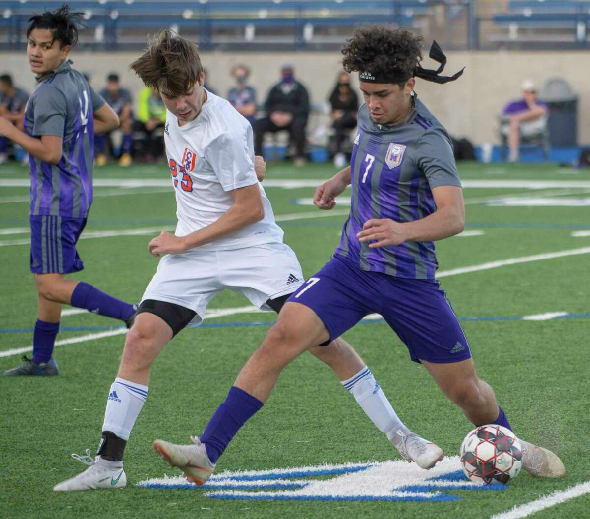 Midland High's Daniel Nunez cuts back to keep San Angelo Central's Riley Wallace from the ball 02/02/2021 at Grande Communications Stadium. Tim Fischer/Reporter-Telegram