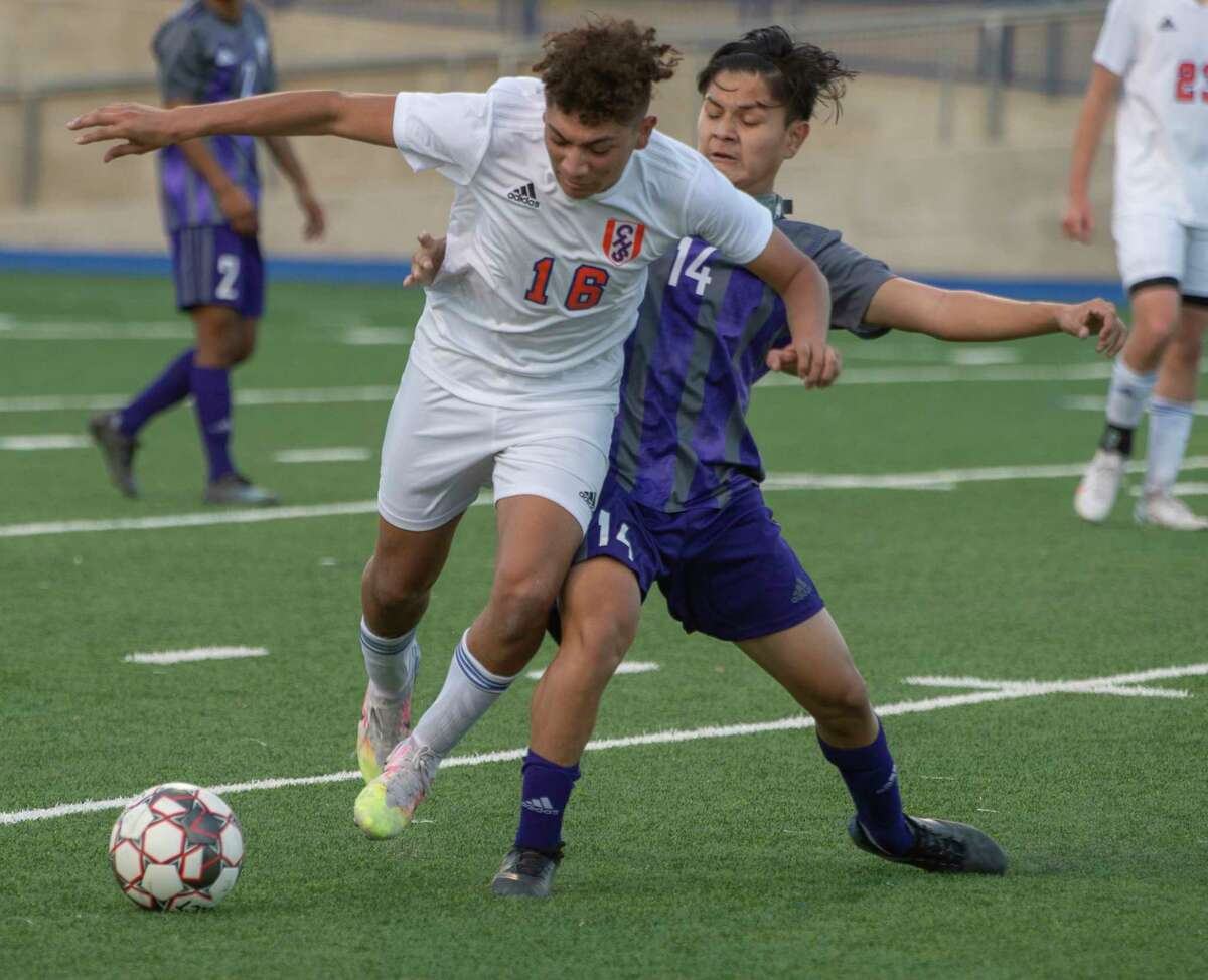 Midland High's Alexander Marquez gets called for a foul as he and San Angelo Central's Mario Lopez battle for the ball 02/02/2021 at Grande Communications Stadium. Tim Fischer/Reporter-Telegram