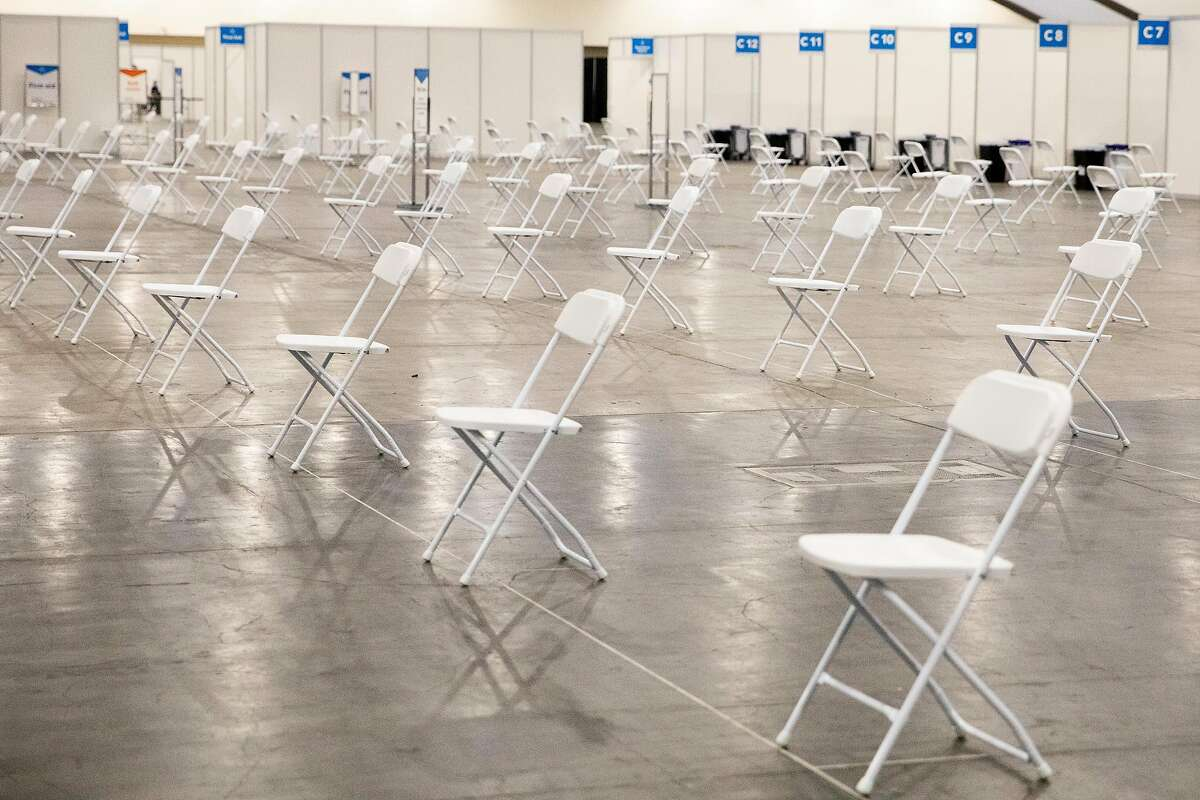 Chairs are set up in a socially distanced manner at a new COVID-19 vaccination site at Moscone South in San Francisco.