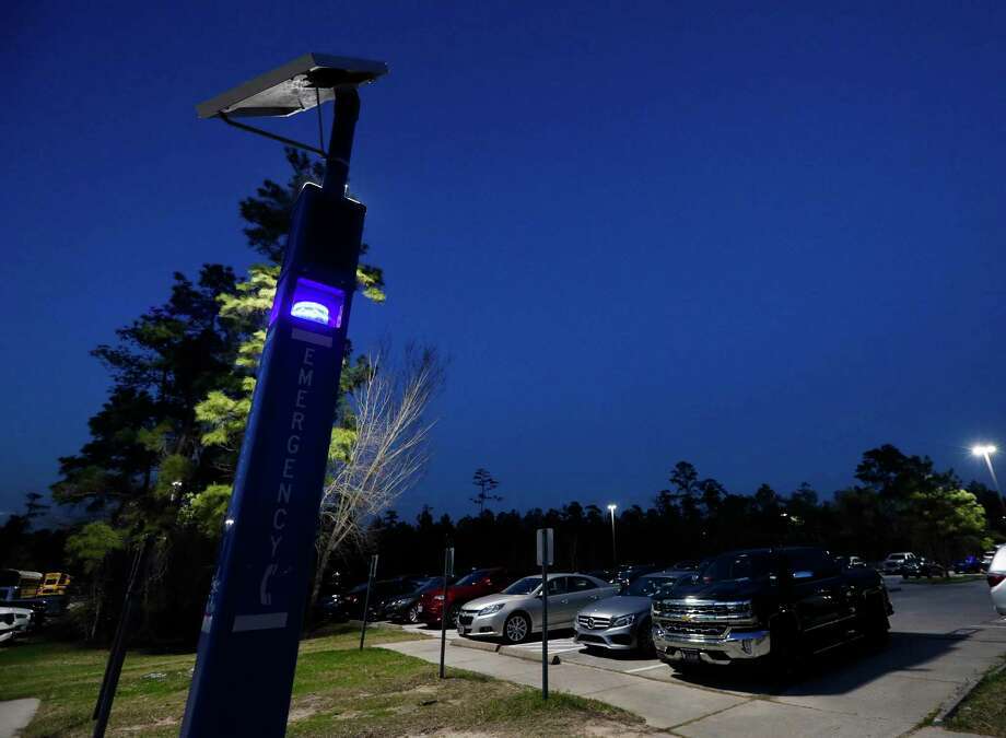 An emergency call tower is seen near the student parking lot at The Woodlands High School, Tuesday, Feb. 2, 2020, in The Woodlands. Emergency towers were placed on all high school and ninth grade campuses, along with other security upgrades as part of a $1 million grant from the Texas Education Agency. Photo: Jason Fochtman, Houston Chronicle / Staff Photographer / 2021 © Houston Chronicle