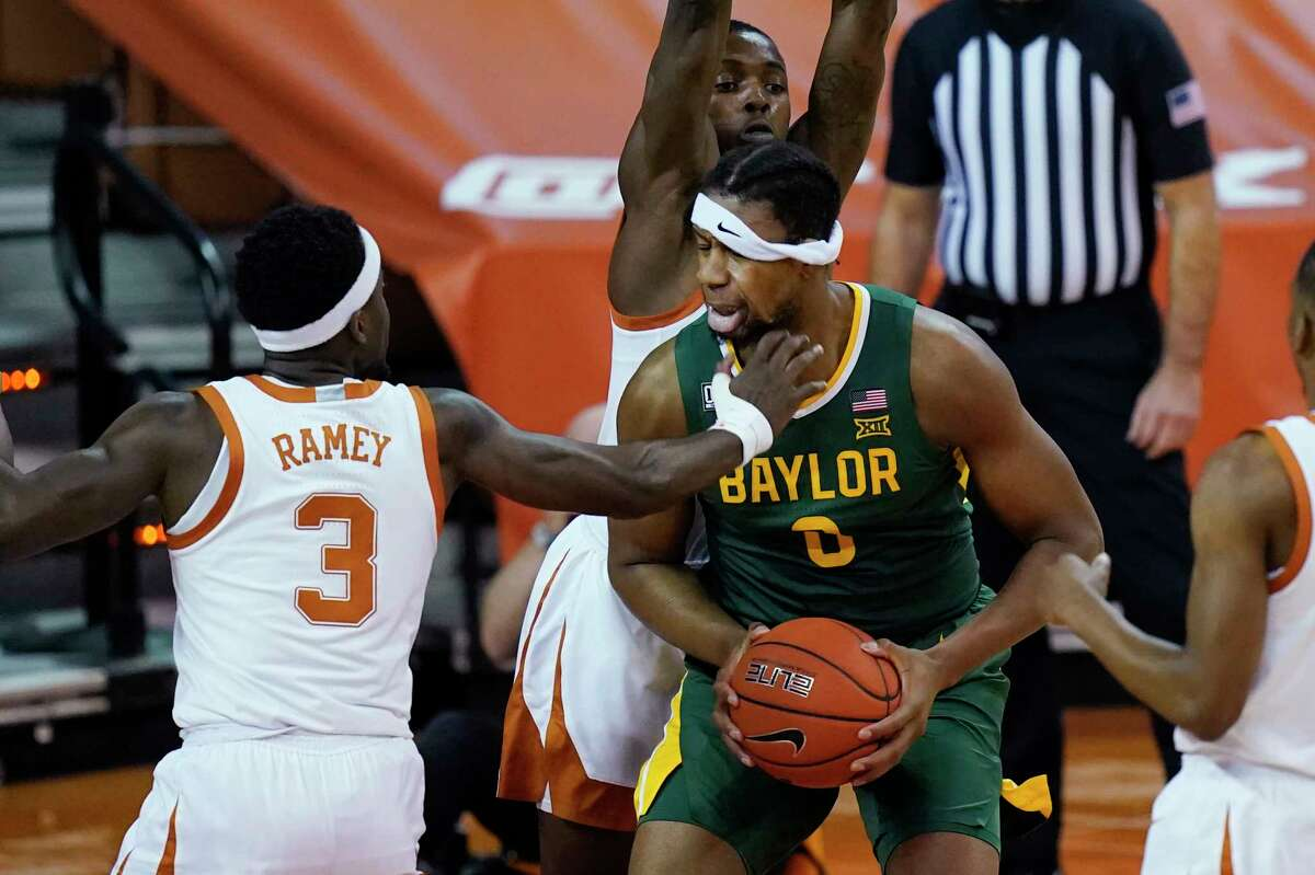 Baylor forward Flo Thamba (0) is pressured by Texas guard Courtney Ramey (3) during the first half of an NCAA college basketball game Tuesday, Feb. 2, 2021, in Austin, Texas. (AP Photo/Eric Gay)