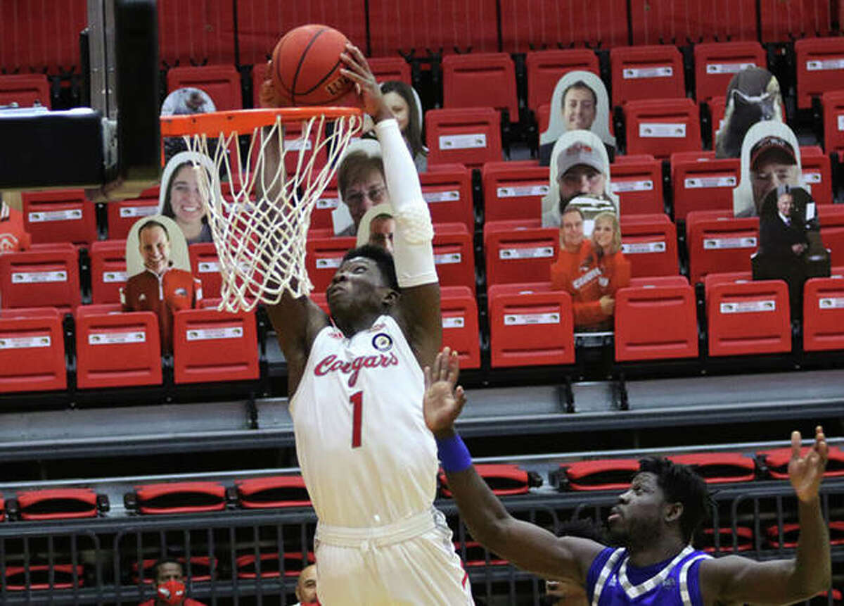SIUE's Mike Adewunmi (1) dunks off a lob pass in the second half against Eastern Illinois on Tuesday at First Community Arena in Edwardsville.