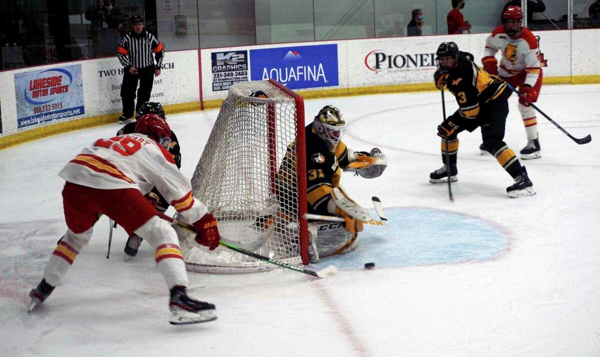 Junior Ethan Stewart, of Ferris State, is denied by Michigan Tech goaltender Blake Pietila during the first period of Tuesday's game at Ewigleben Ice Arena. (Pioneer photo/Joe Judd)