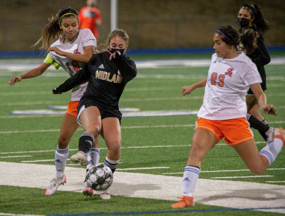 Midland High's Tess Maylett tries to keep San Angelo Central's Angel Alvarado away from the ball as Central's Alyssa Villareal comes to help 02/02/2021 at Grande Communications Stadium. Tim Fischer/Reporter-Telegram Photo: Tim Fischer, Midland Reporter-Telegram