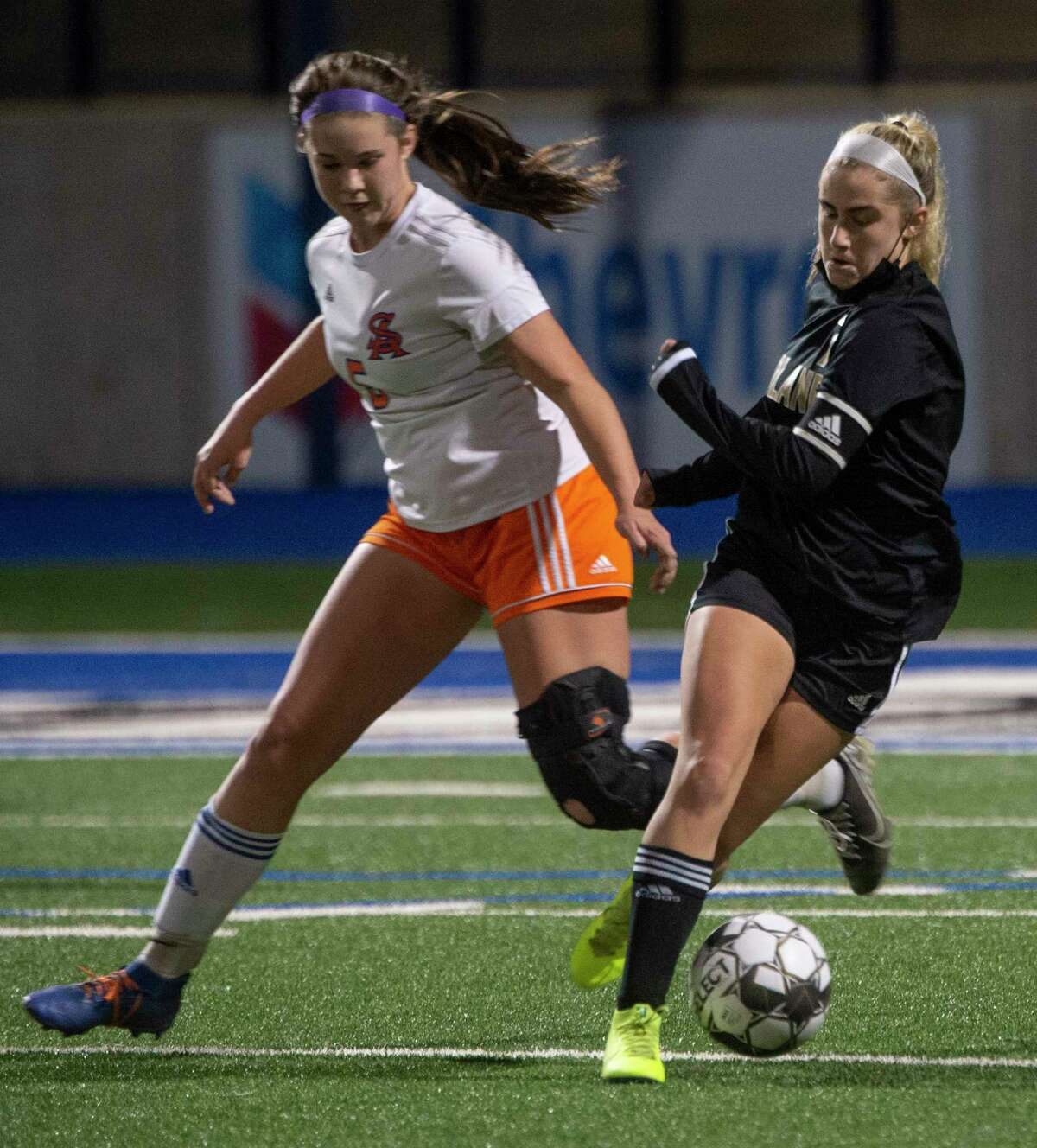 Midland High's Kinsey Hill cuts back to get away from San Angelo Central's Alexis Templin 02/02/2021 at Grande Communications Stadium. Tim Fischer/Reporter-Telegram