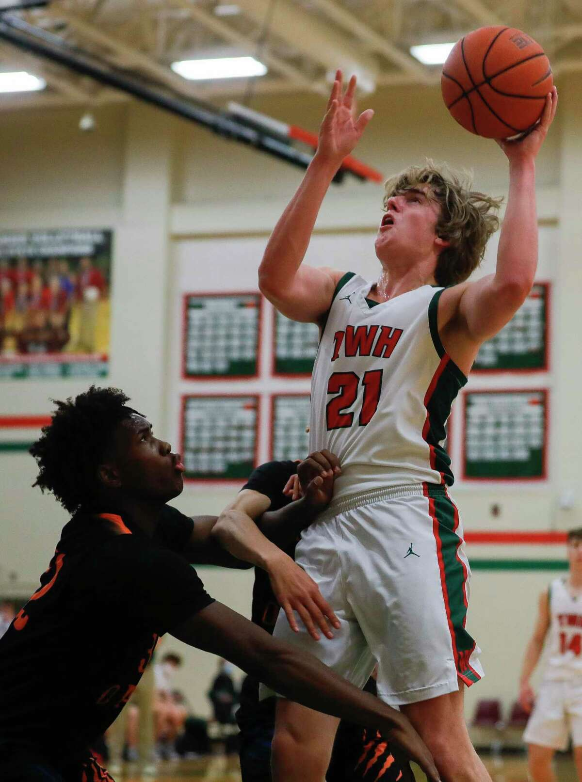 during the first quarter of a District 13-6A high school basketball game at The Woodlands High School, Tuesday, Feb. 2, 2020, in The Woodlands.