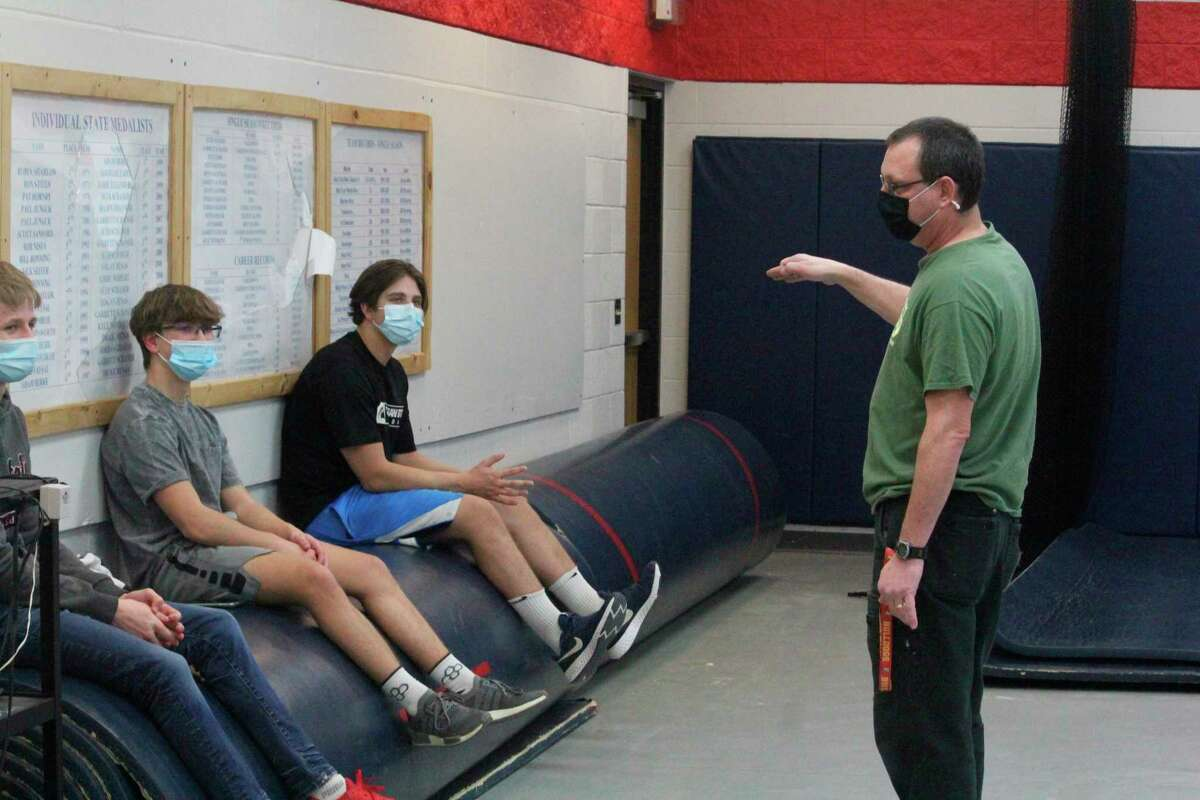 Big Rapids wrestling coach Bruce Hoffman (right) talks to three of his wrestlers after Monday's practice. (Pioneer photo/John Raffel)