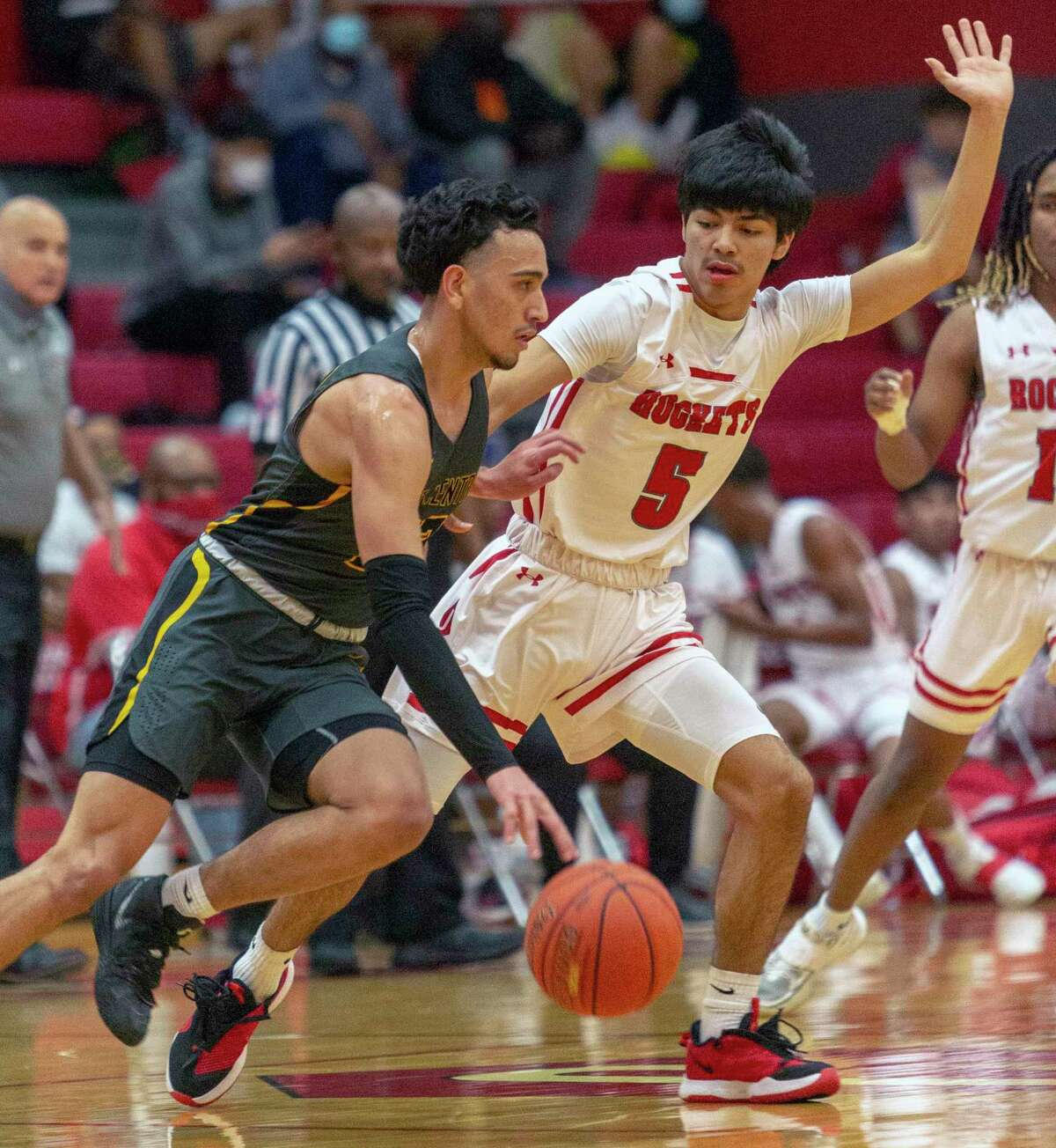 East Central's Jeremiah Brooks drives Tuesday night, Feb. 2, 2021 at Judson High School past Judson's Donavan Gomez during the first half of the Rockets' game against the Hornets.