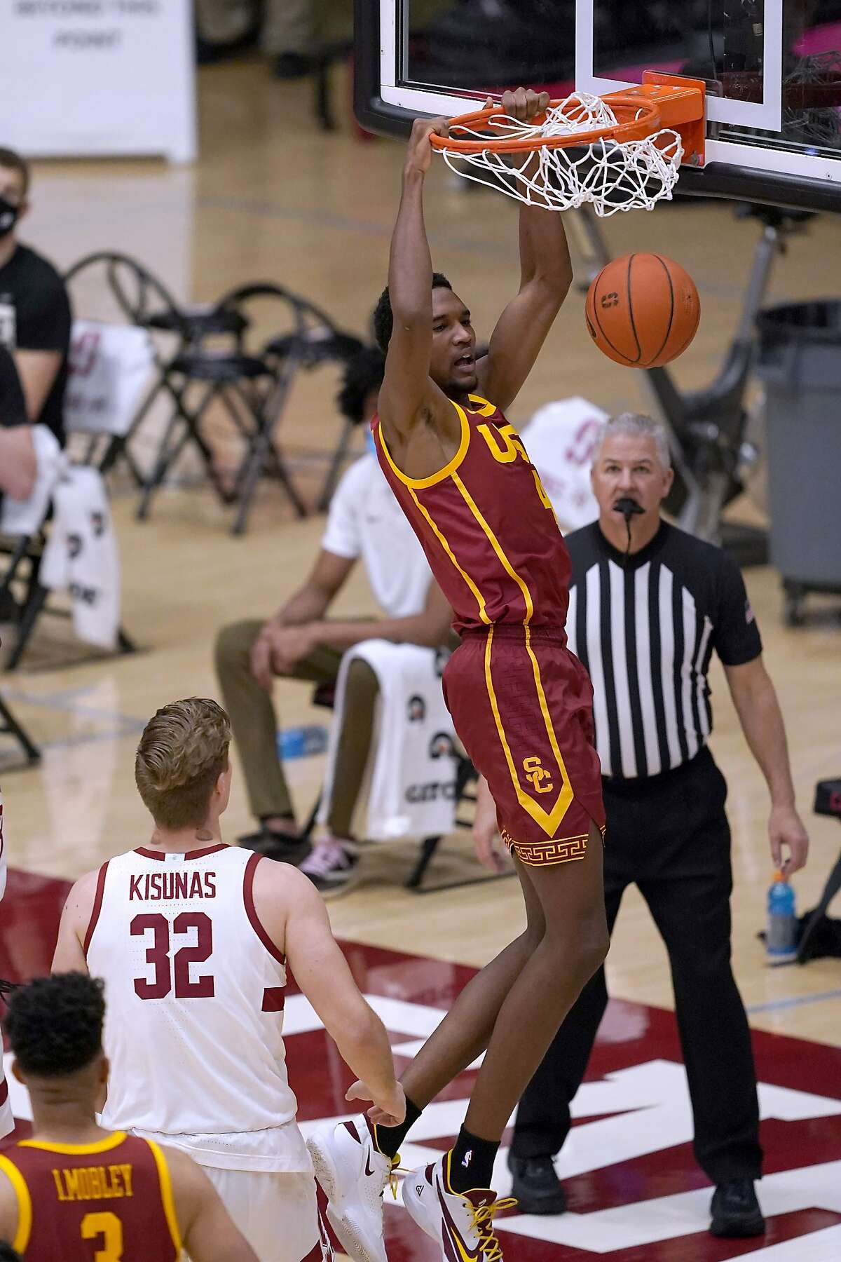 Southern California forward Evan Mobley (4) dunks past Stanford forward Lukas Kisunas (32) during the first half of an NCAA college basketball game in Stanford, Calif., Tuesday, Feb. 2, 2021. (AP Photo/Tony Avelar)